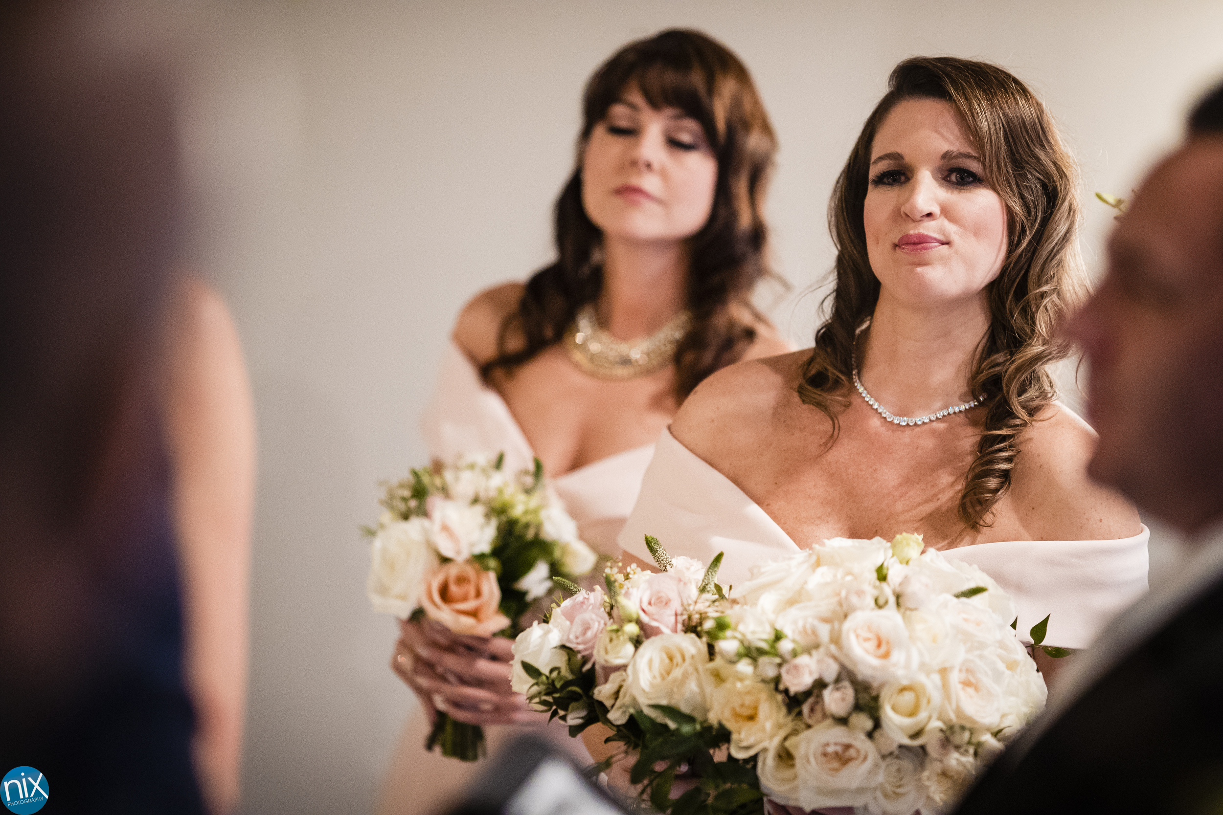 bridemaides during wedding ceremony at The Terrace at Cedar Hill.jpg