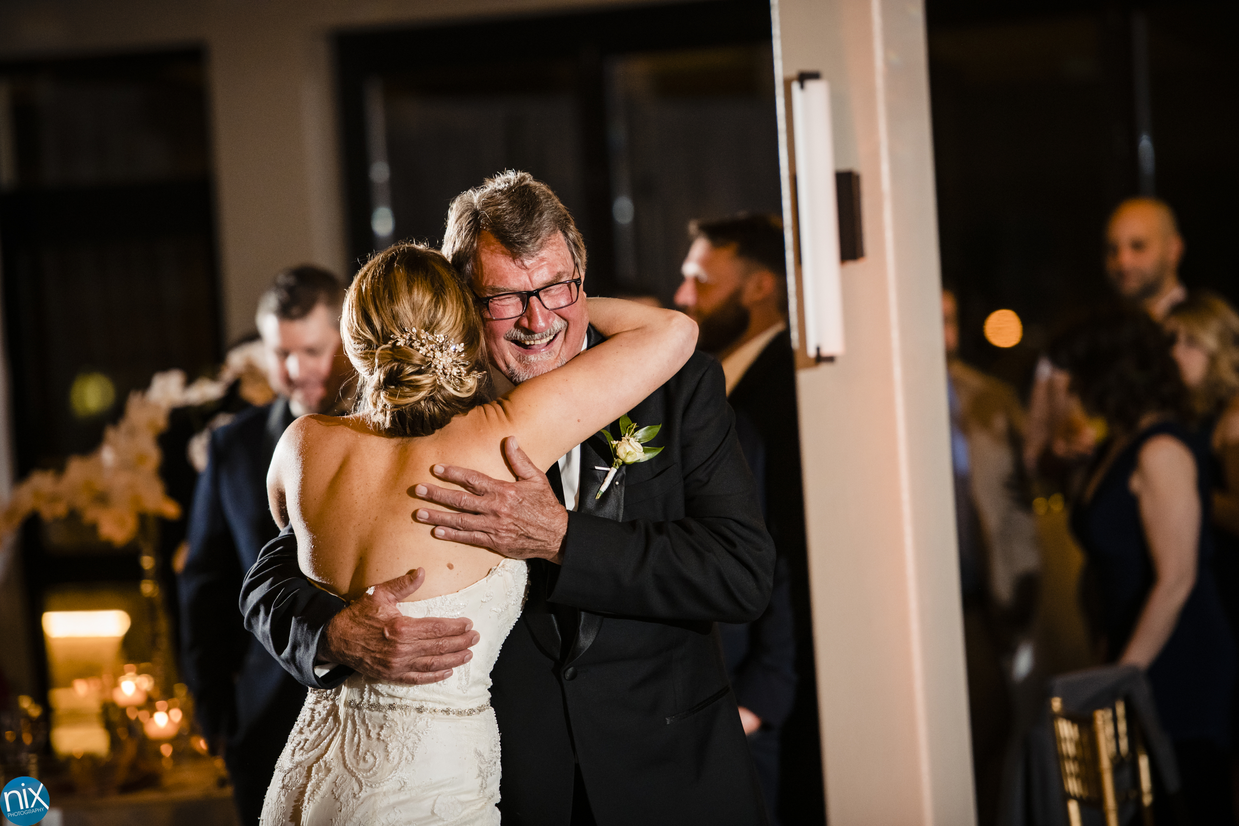 father hugs bride at the Terrace at Cedar Hill wedding.jpg
