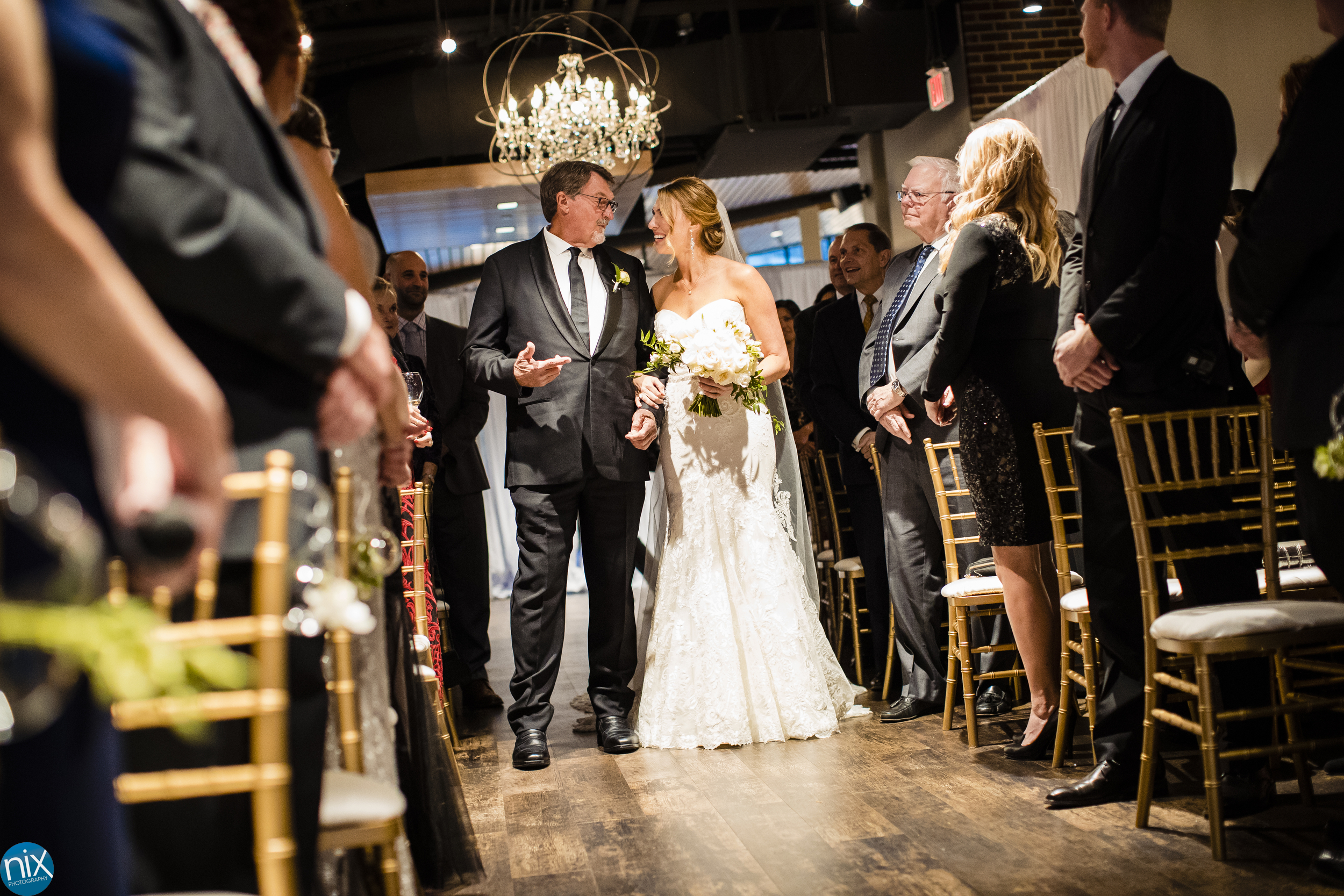 father walks bride down the aisle at The Terrace at Cedar Hill.jpg