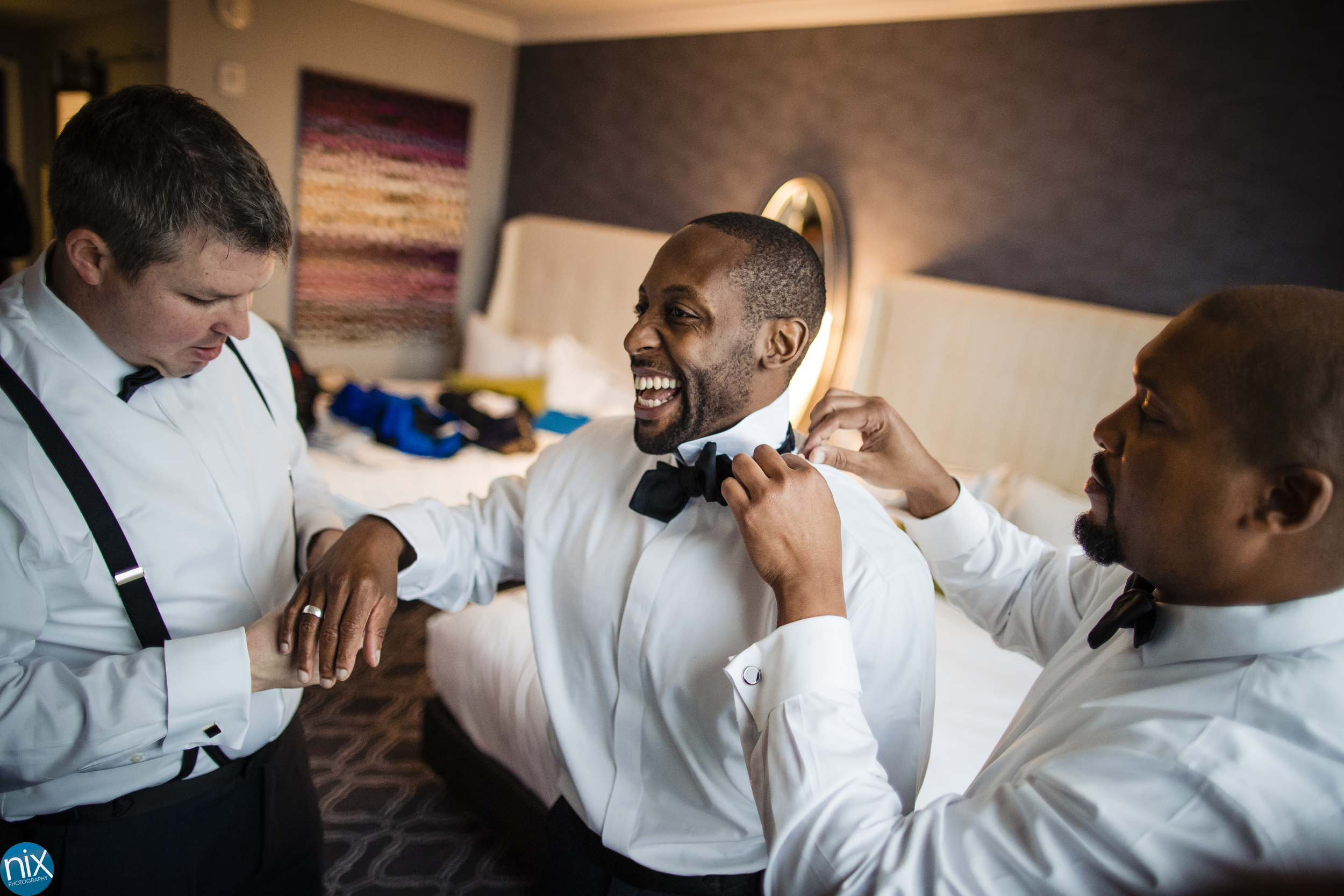 groomsment laigh before a wedding at Kimpton Tryon Park Hotel in Charlotte.jpg