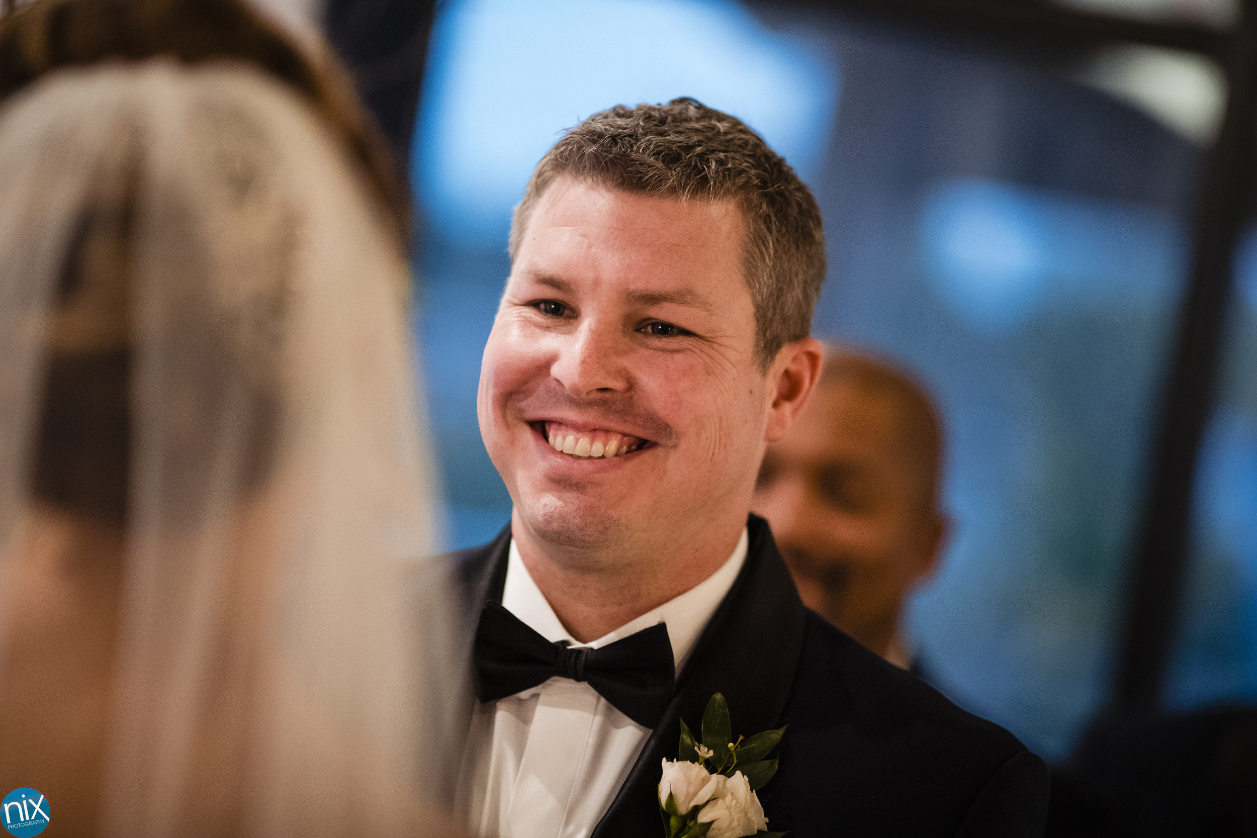 groom smiles at bride during wedding ceremony at The Terrace at Cedar Hill.jpg