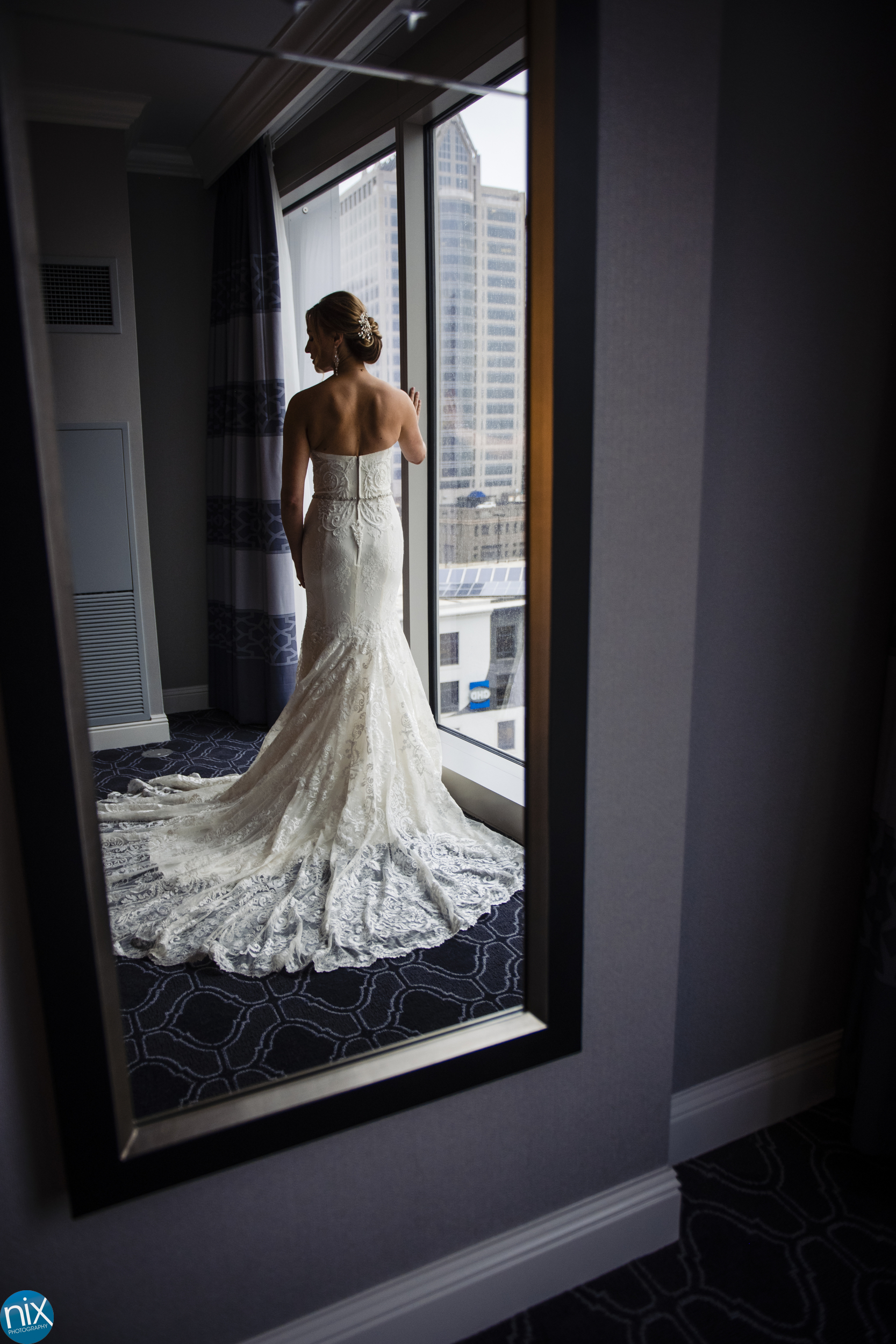 refelection of a bride at Kimpton Tryon Park Hotel in Charlotte.jpg