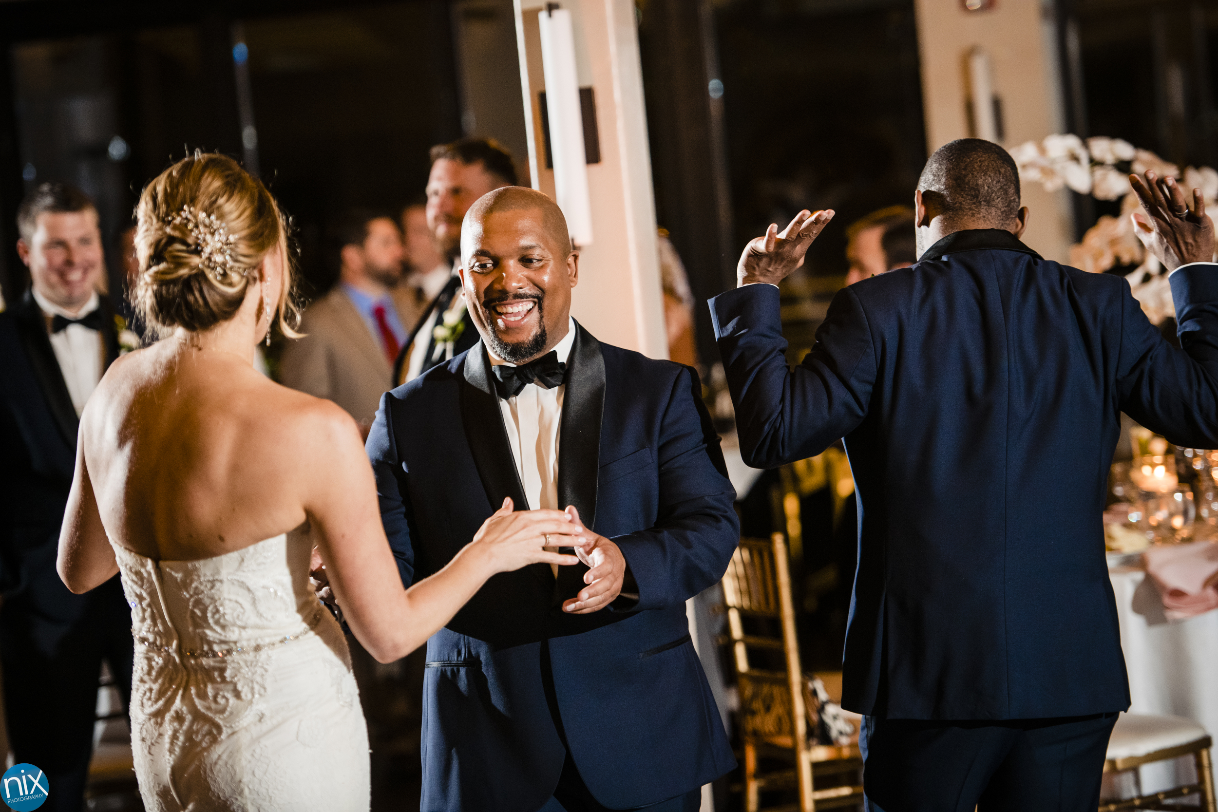 the Terrace at Cedar Hill groomsman dances with bride during wedding reception.jpg