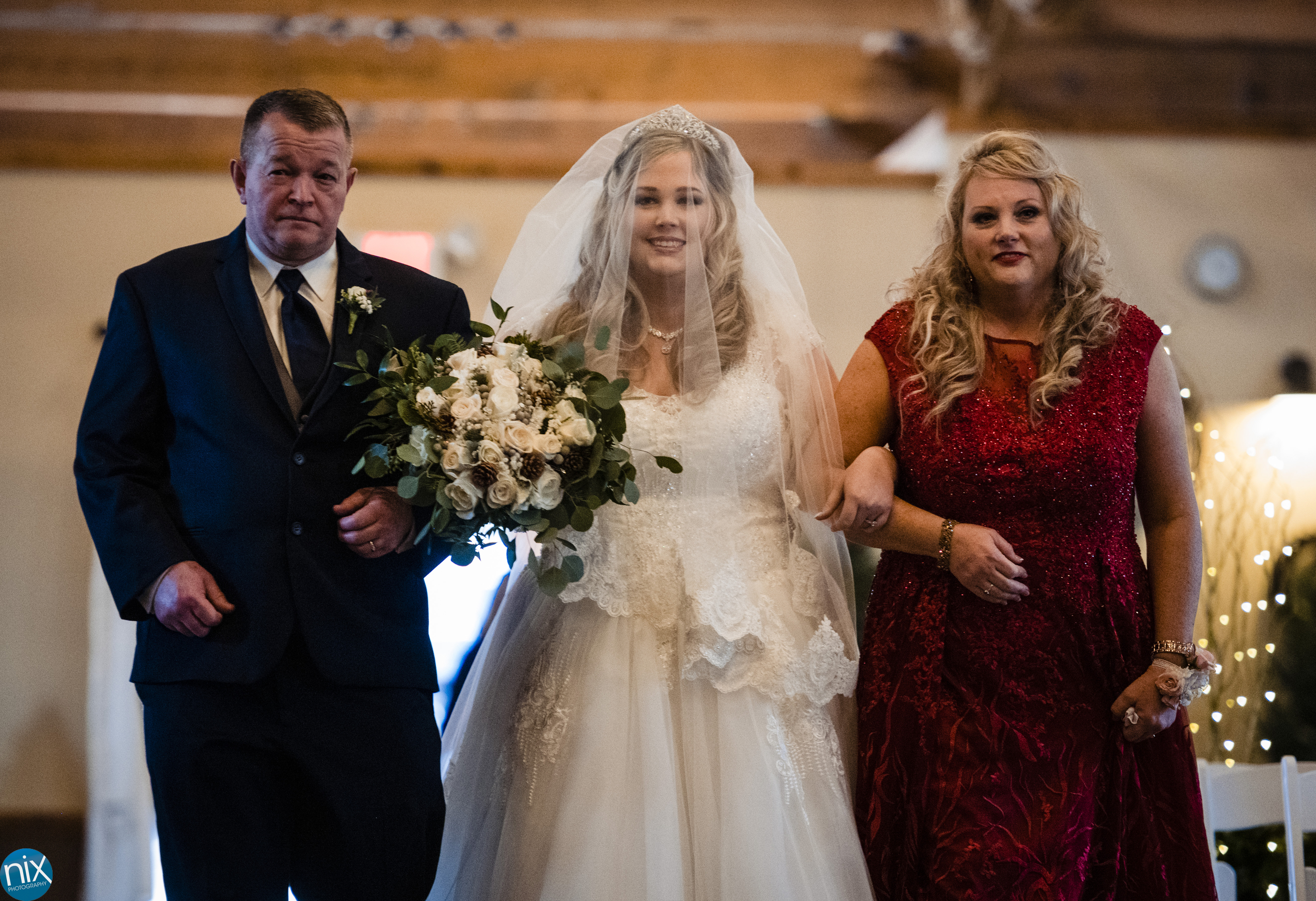 bride and parents walk down the aisle at Laboratory Mills.jpg