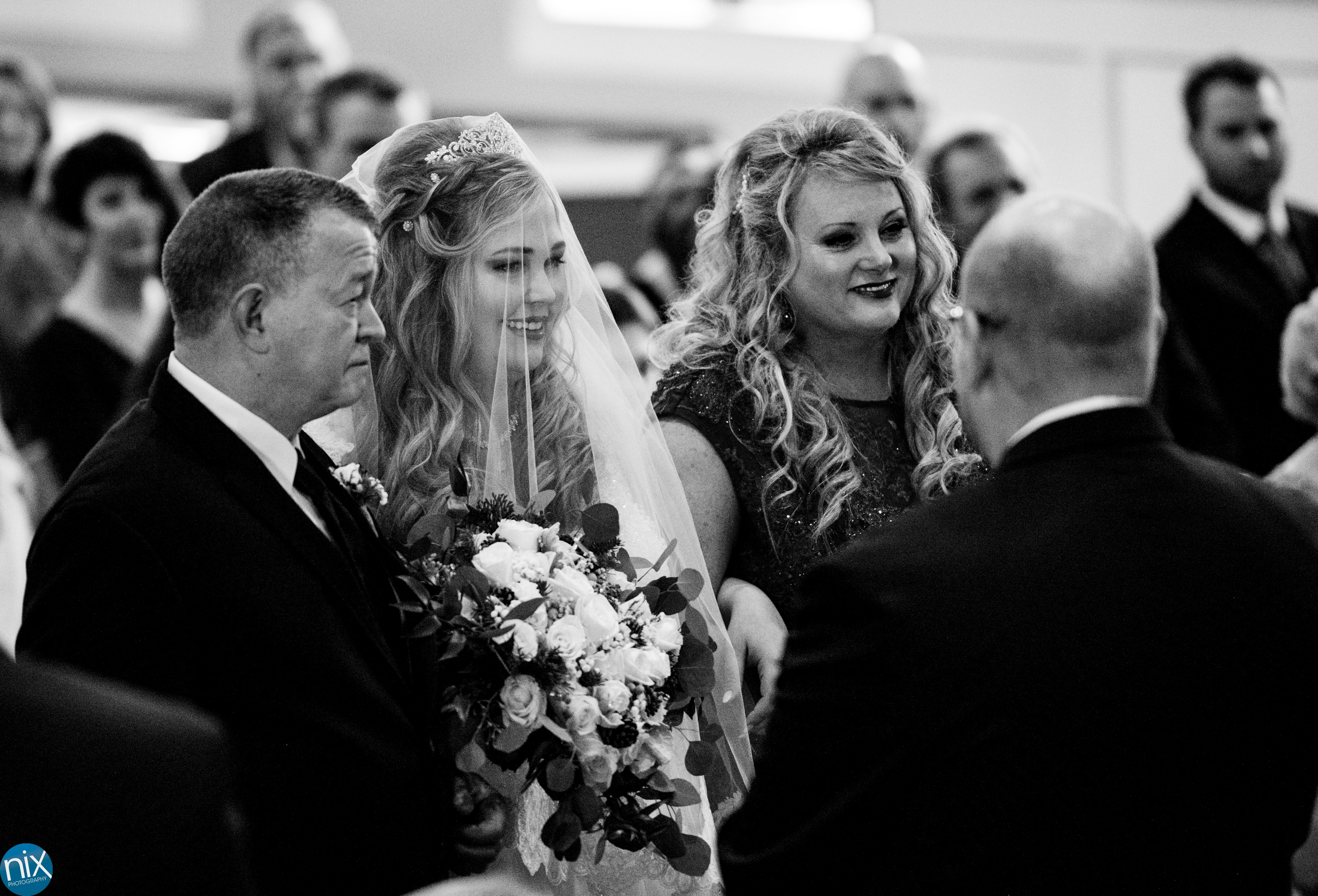 bride with parents at the altar during wedding ceremony at Laboratory Mills.jpg