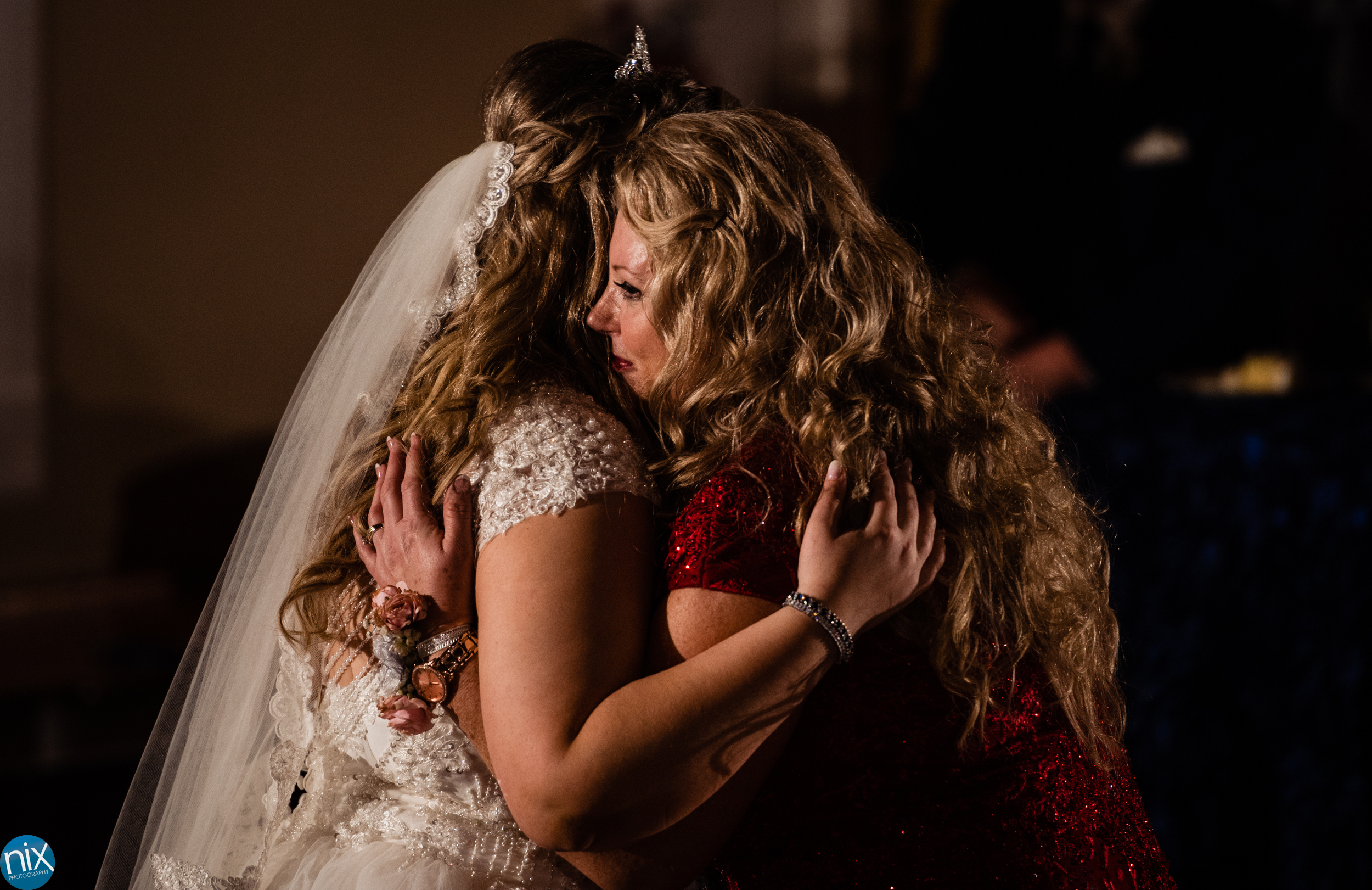 mother hugs bride during wedding at Laboratory Mills.jpg