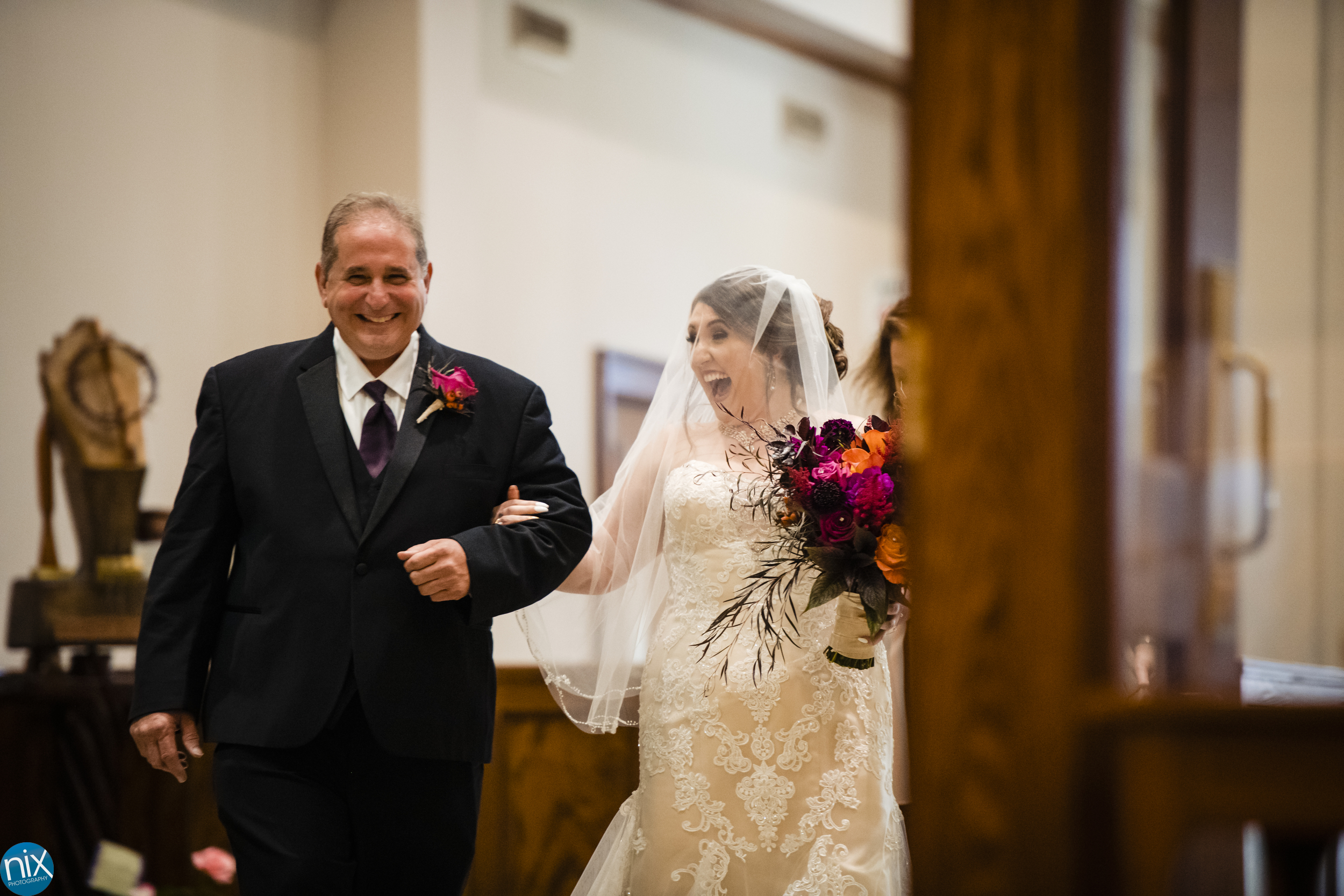 bride and father walk down the aisle .jpg