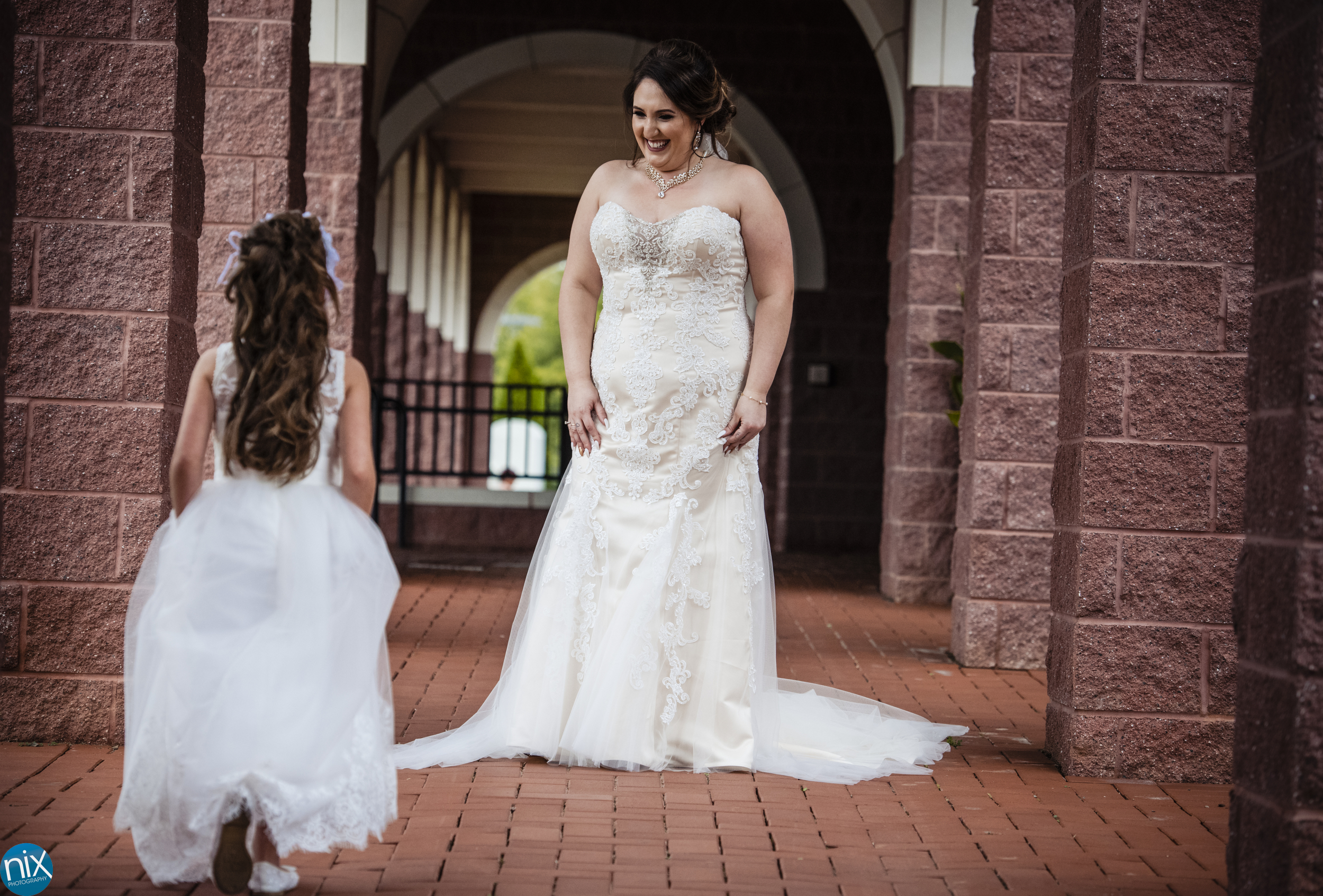 bride and flower girl at St Philip Neri Catholic Church.jpg