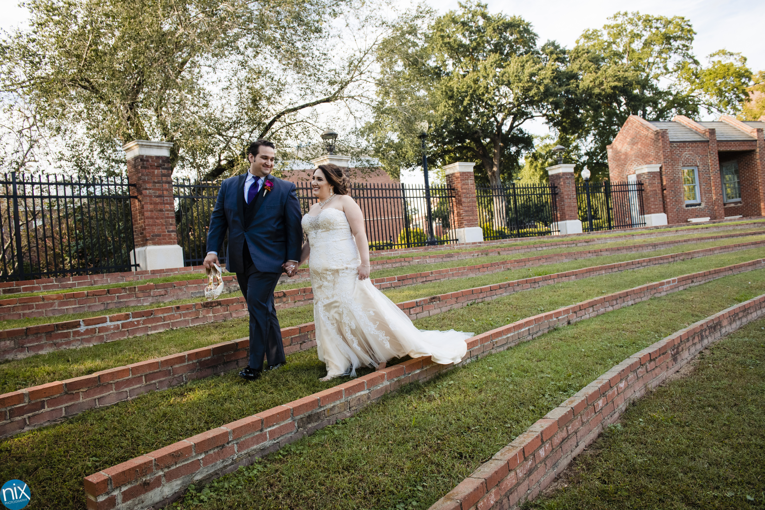 bride and groom walk at Winthrop University.jpg