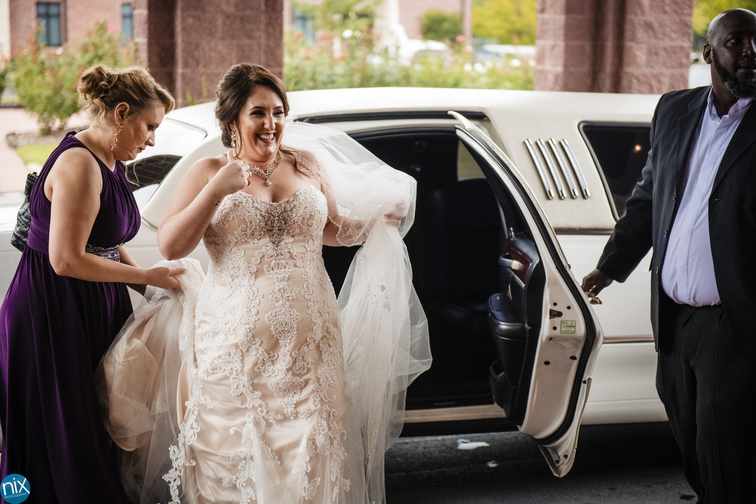 bride arrives for her wedding at St Philip Neri Catholic Church.jpg
