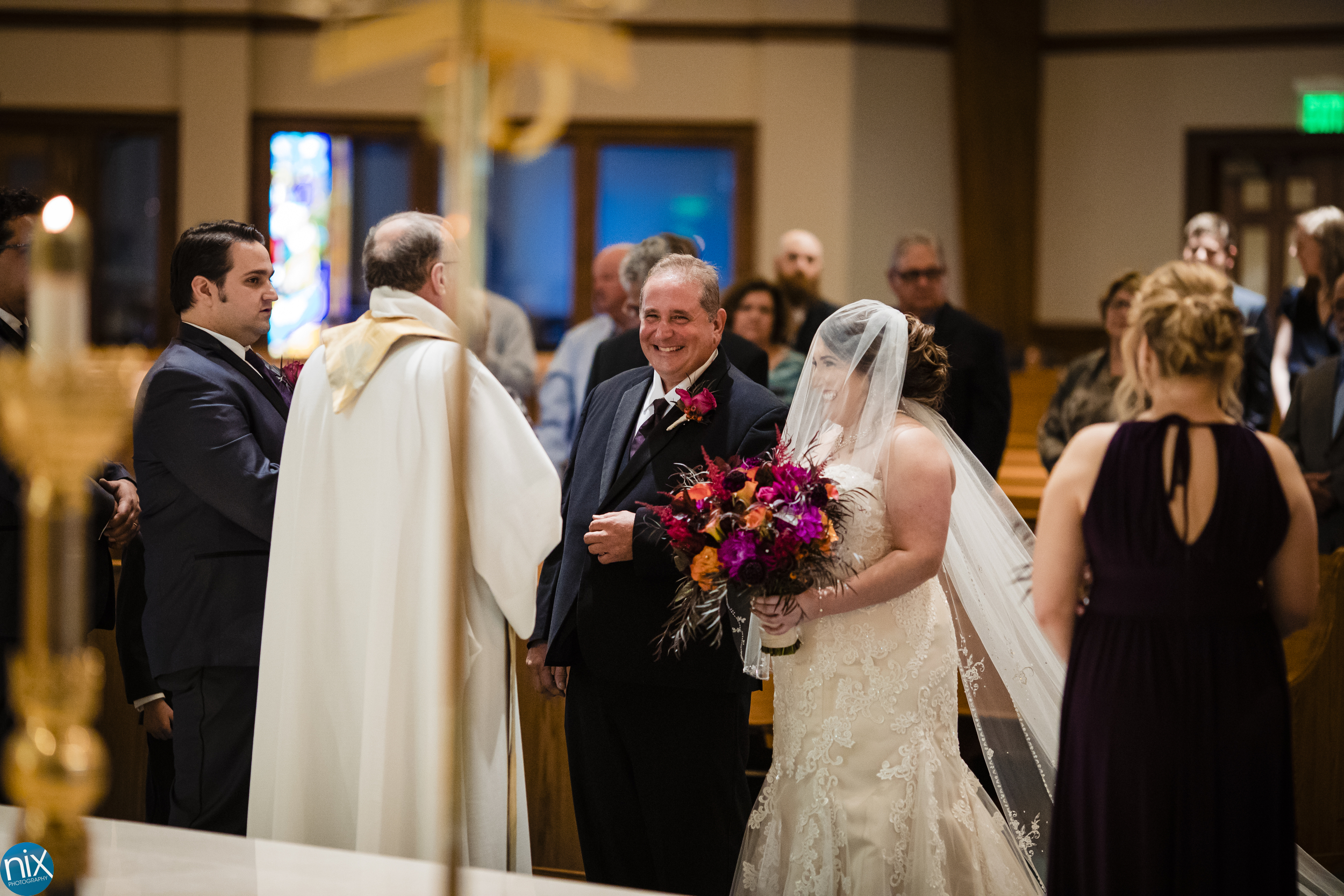 father smiles as he gives bride away at St Philip Neri.jpg