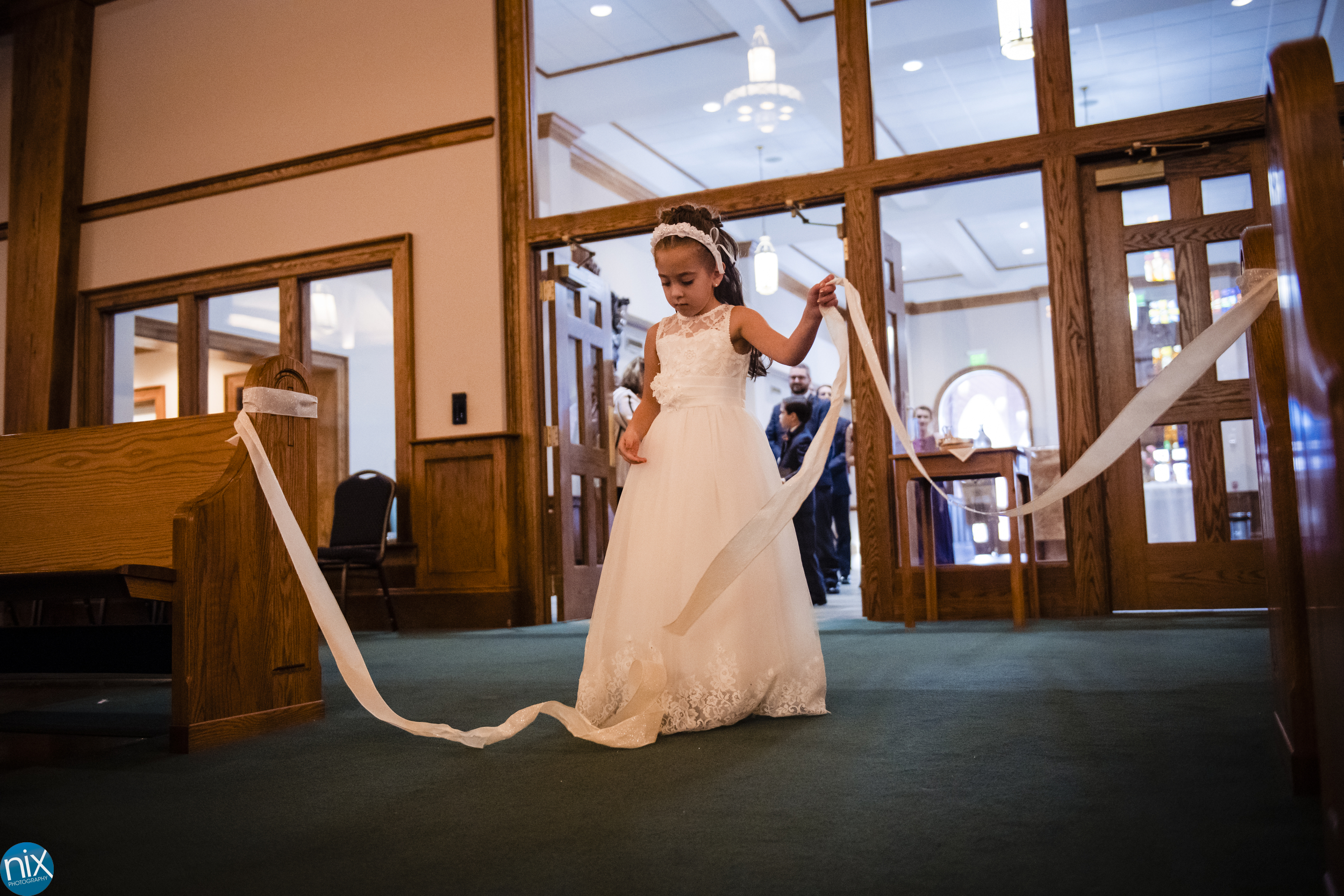 flower girl during ceremony at St Philip Neri Catholic Church.jpg
