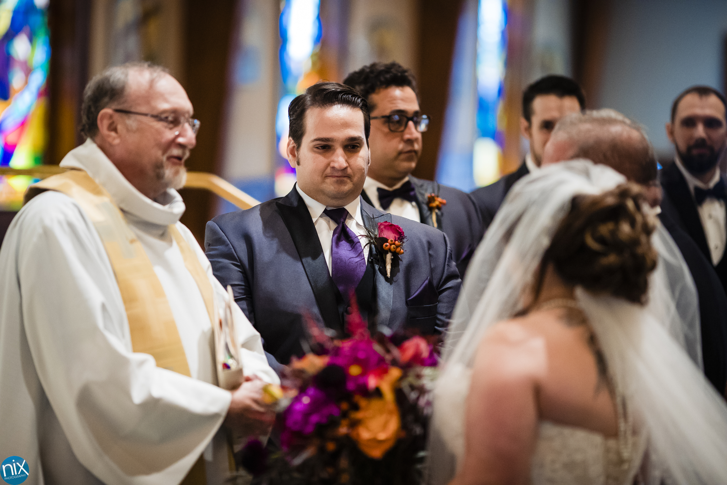 groom looks at bride during wedding ceremony.jpg