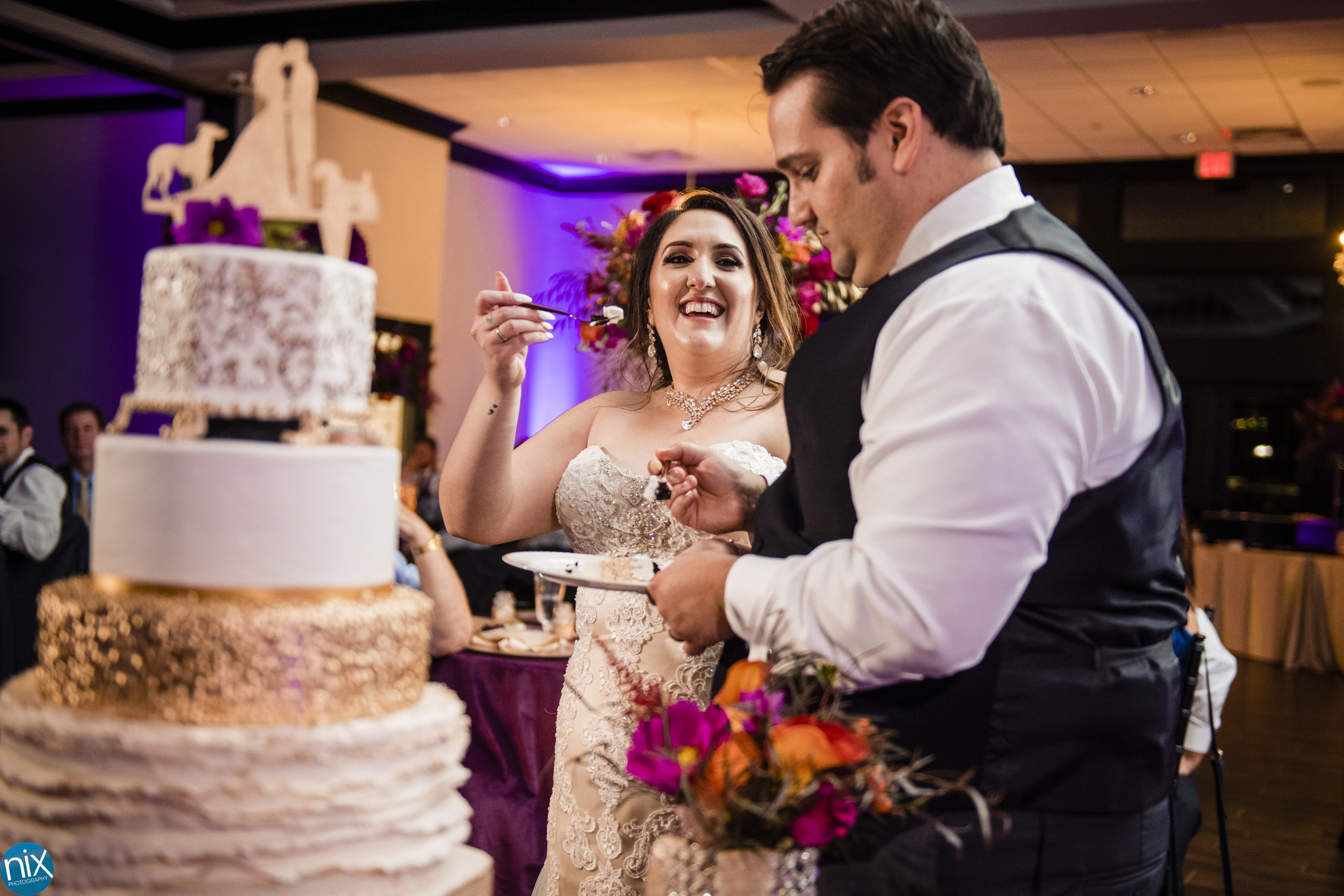 wedding cake is cut at Southern Charm Events.jpg