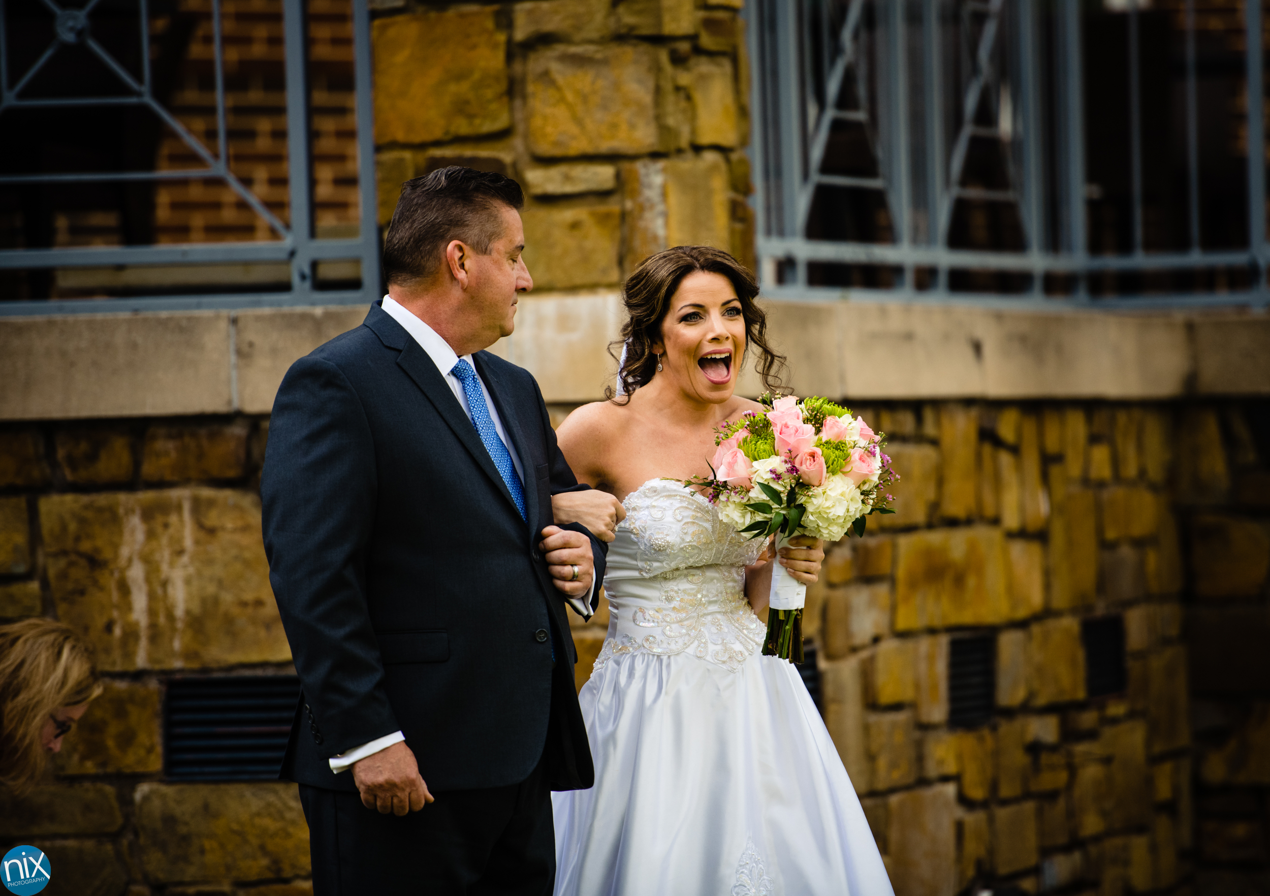 bride and father walk down the aisle at River Run Country Club