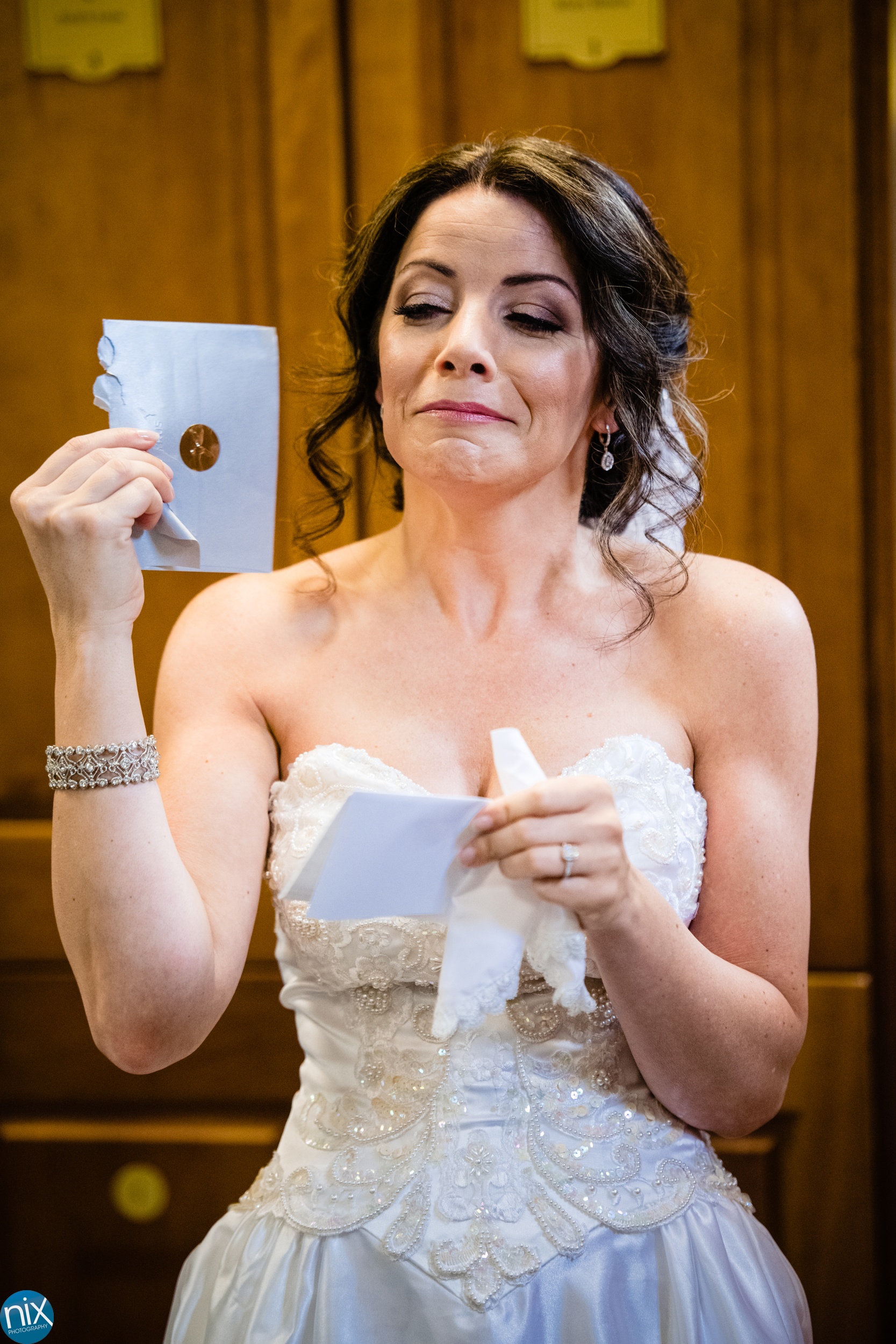 bride cries while readding letter from her future husband