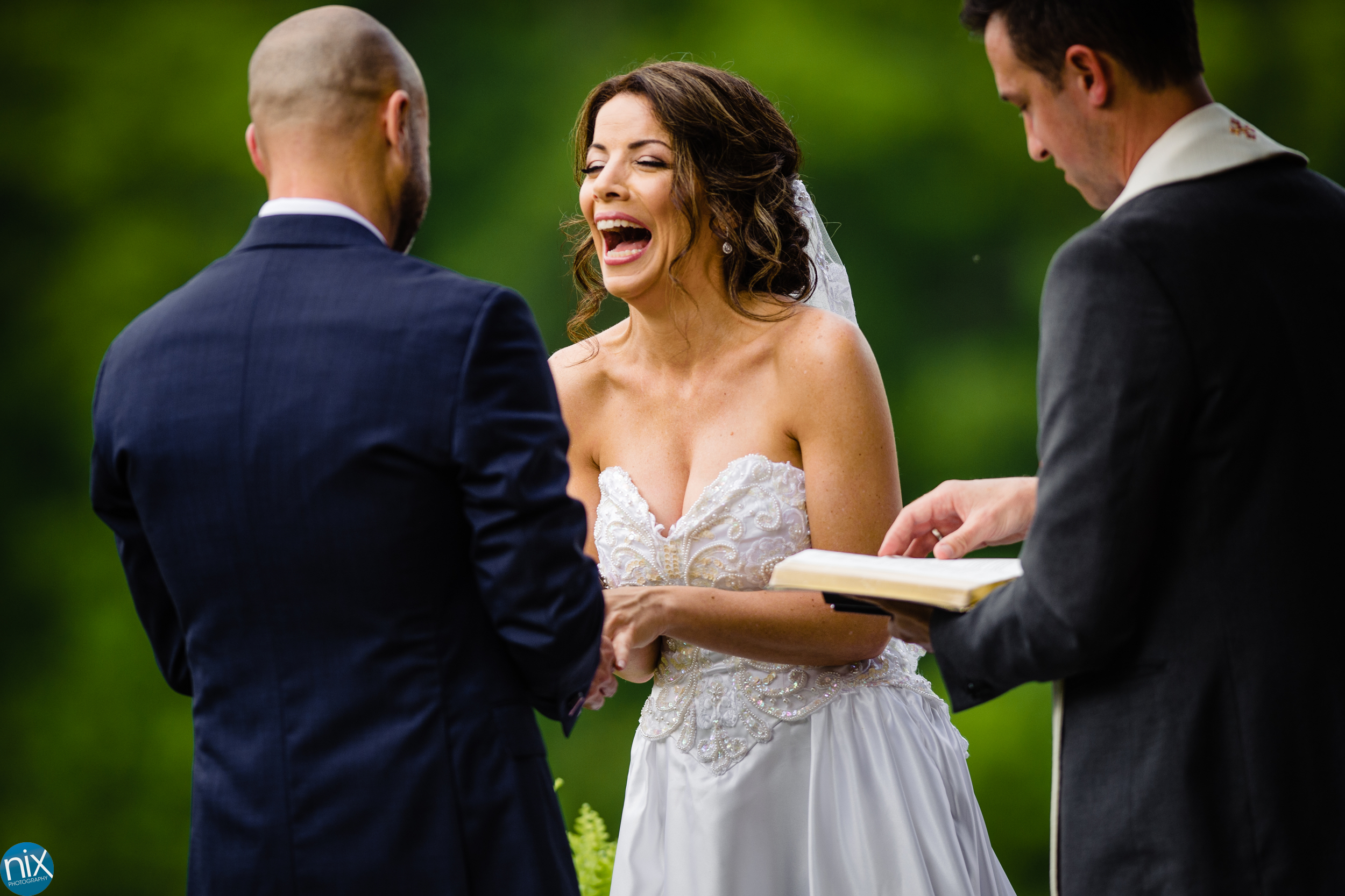 bride laughs during ceremony at River Run Country Club