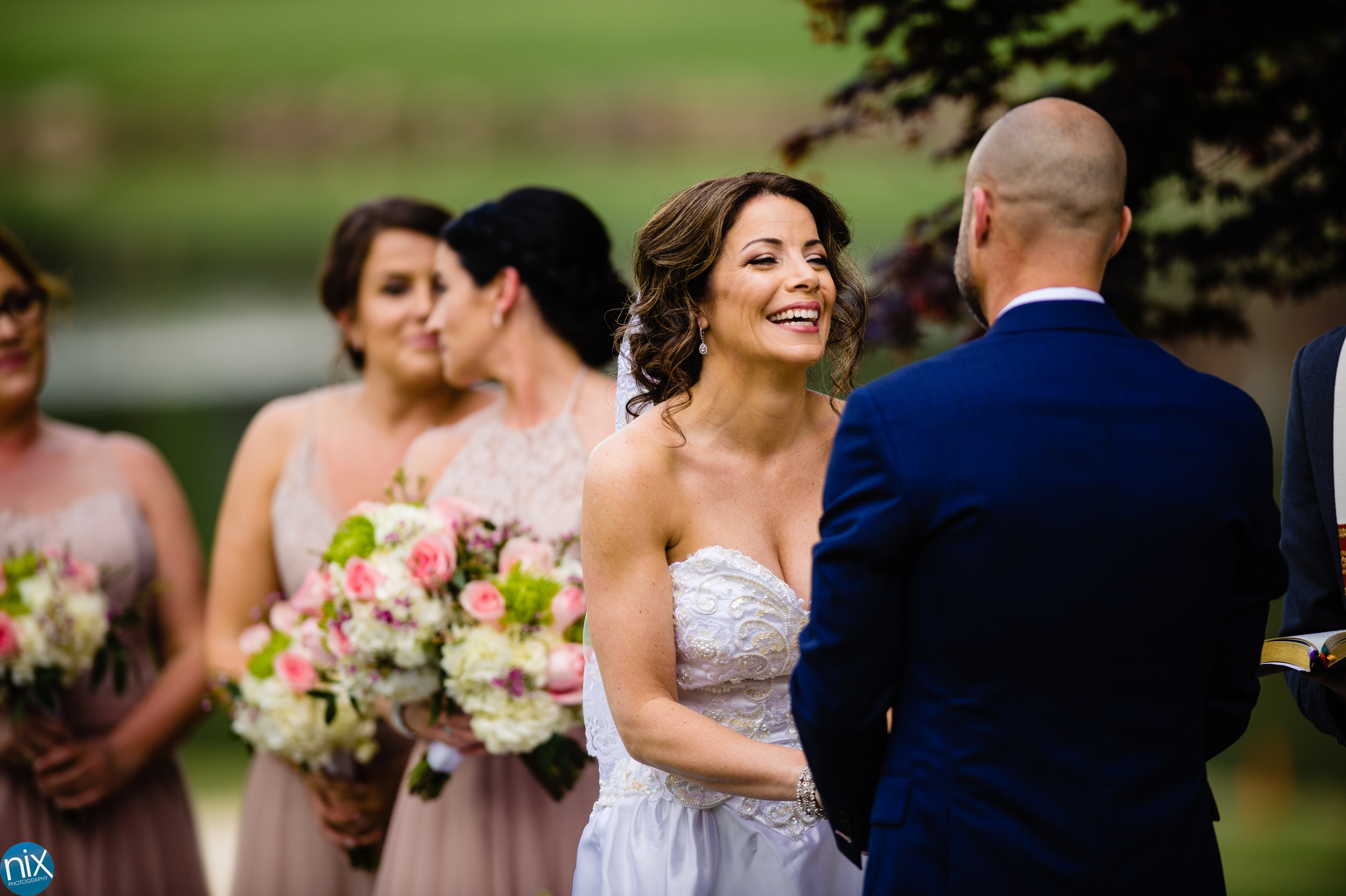 bride laughs while looking at groom