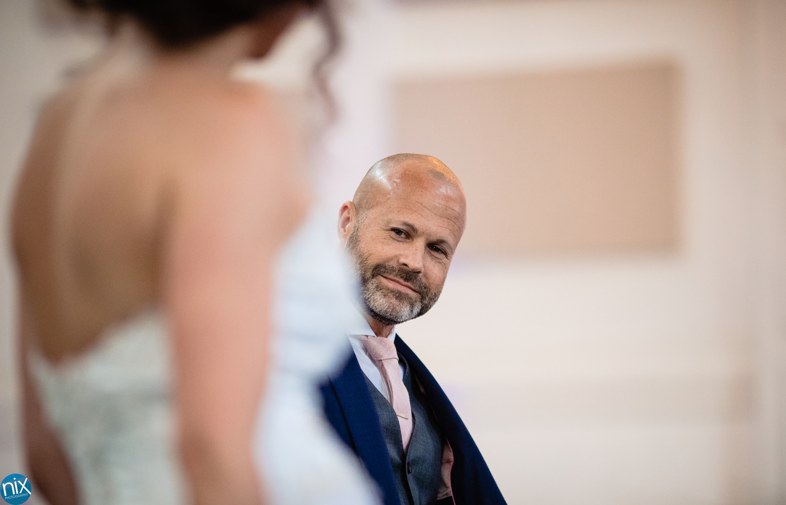 groom checks out bride at River Run Country Club