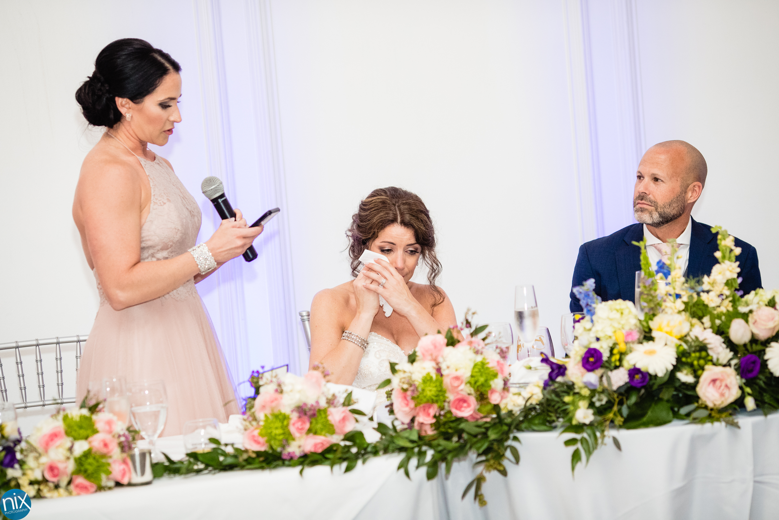 matron of honor toasts bride and groom