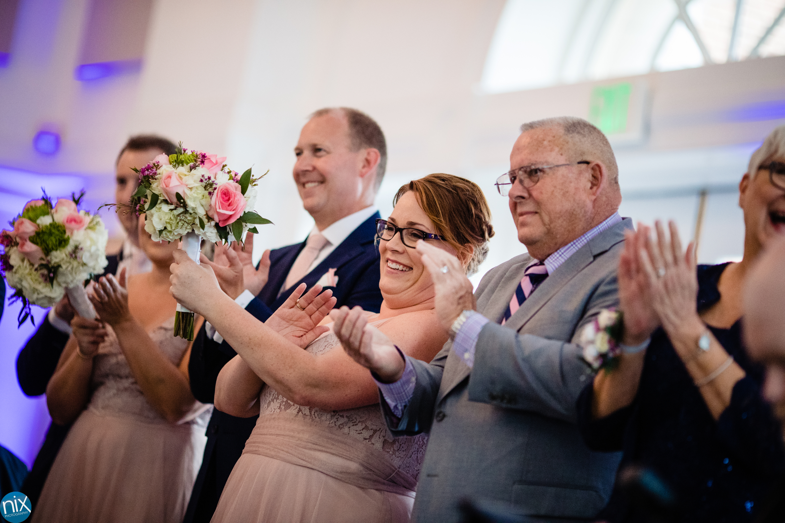 wedding party claps during reception