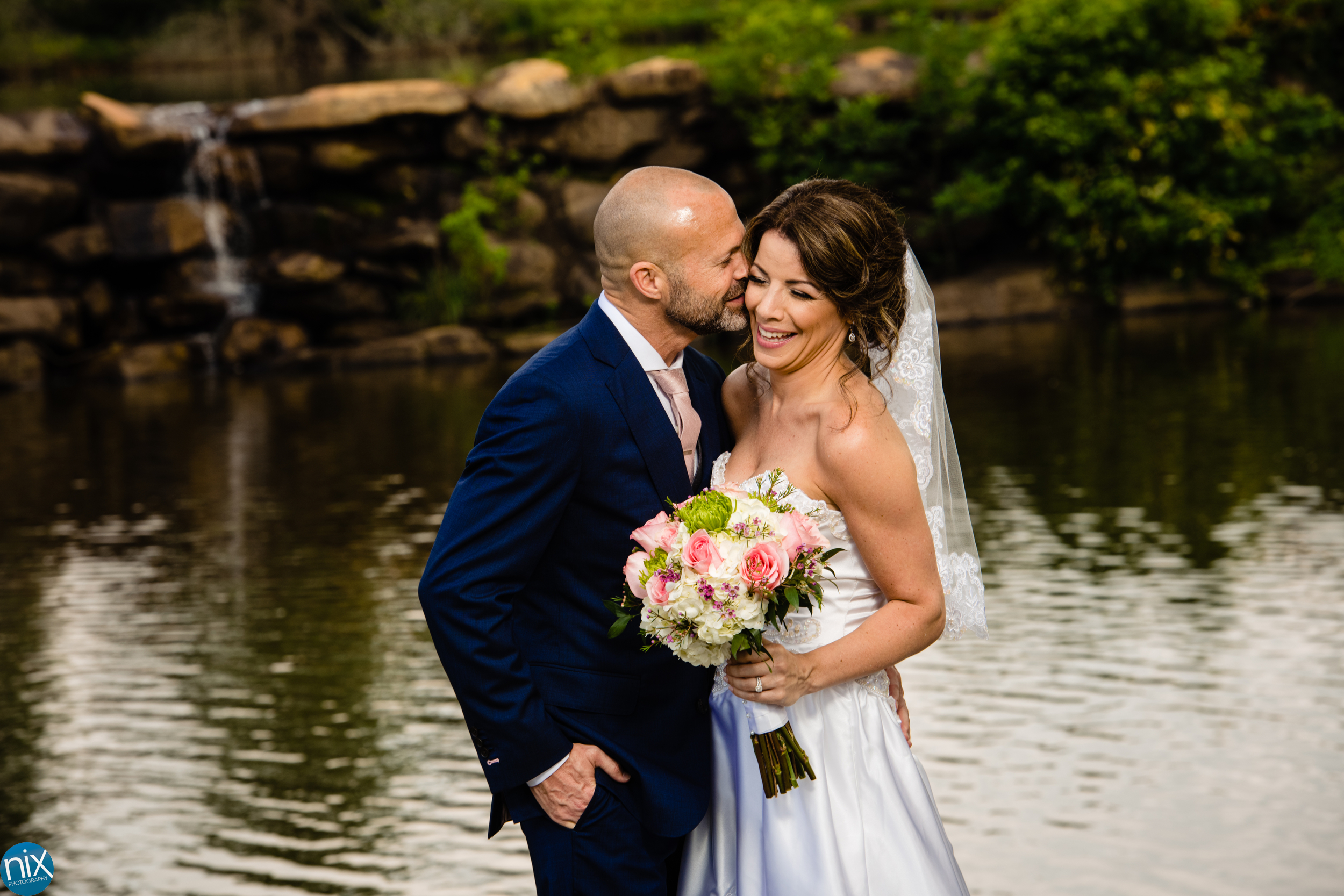 wedding portrait by waterfall at River Run Country Club