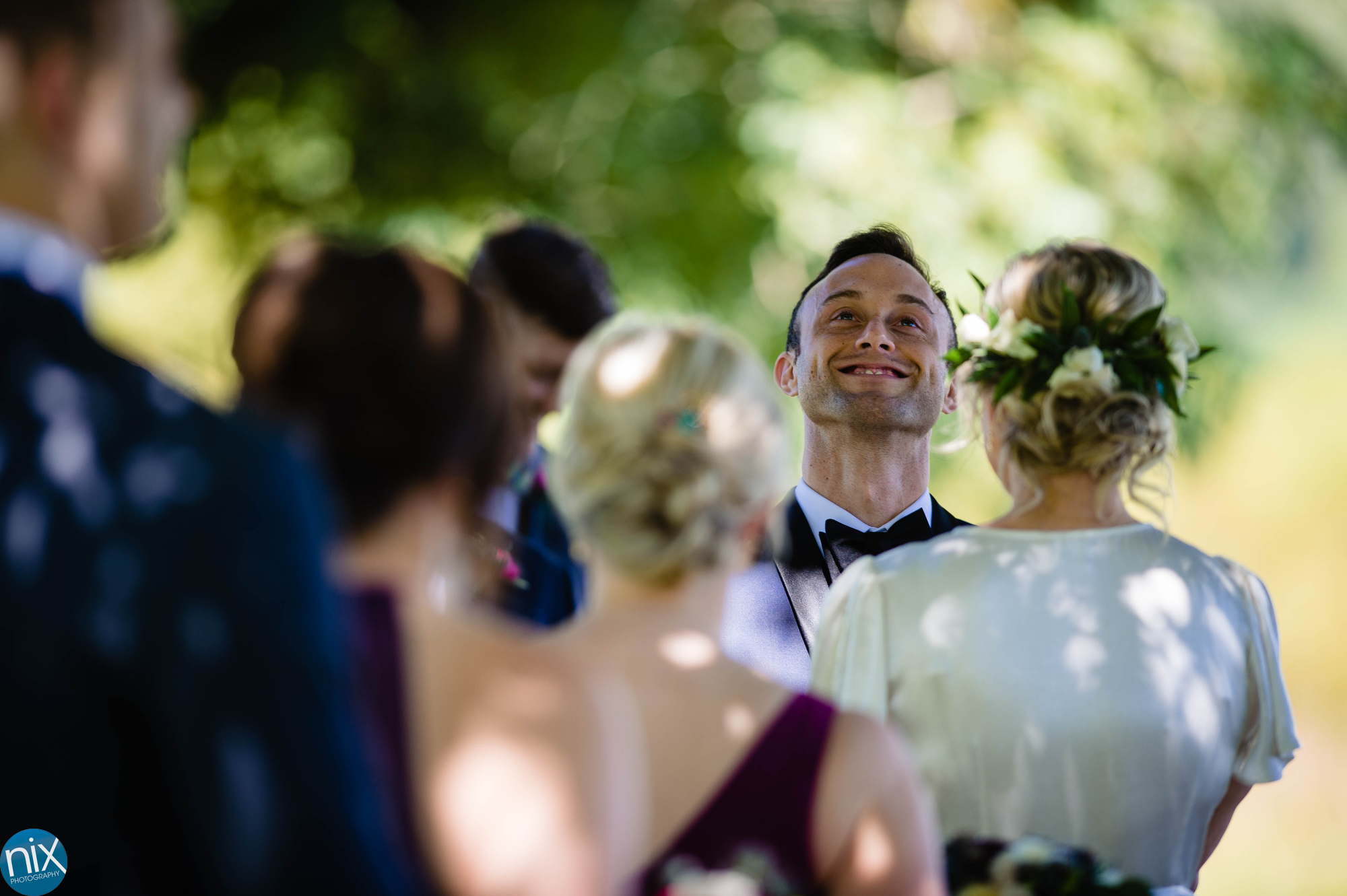 groom takes it all in during wedding ceremony .JPG