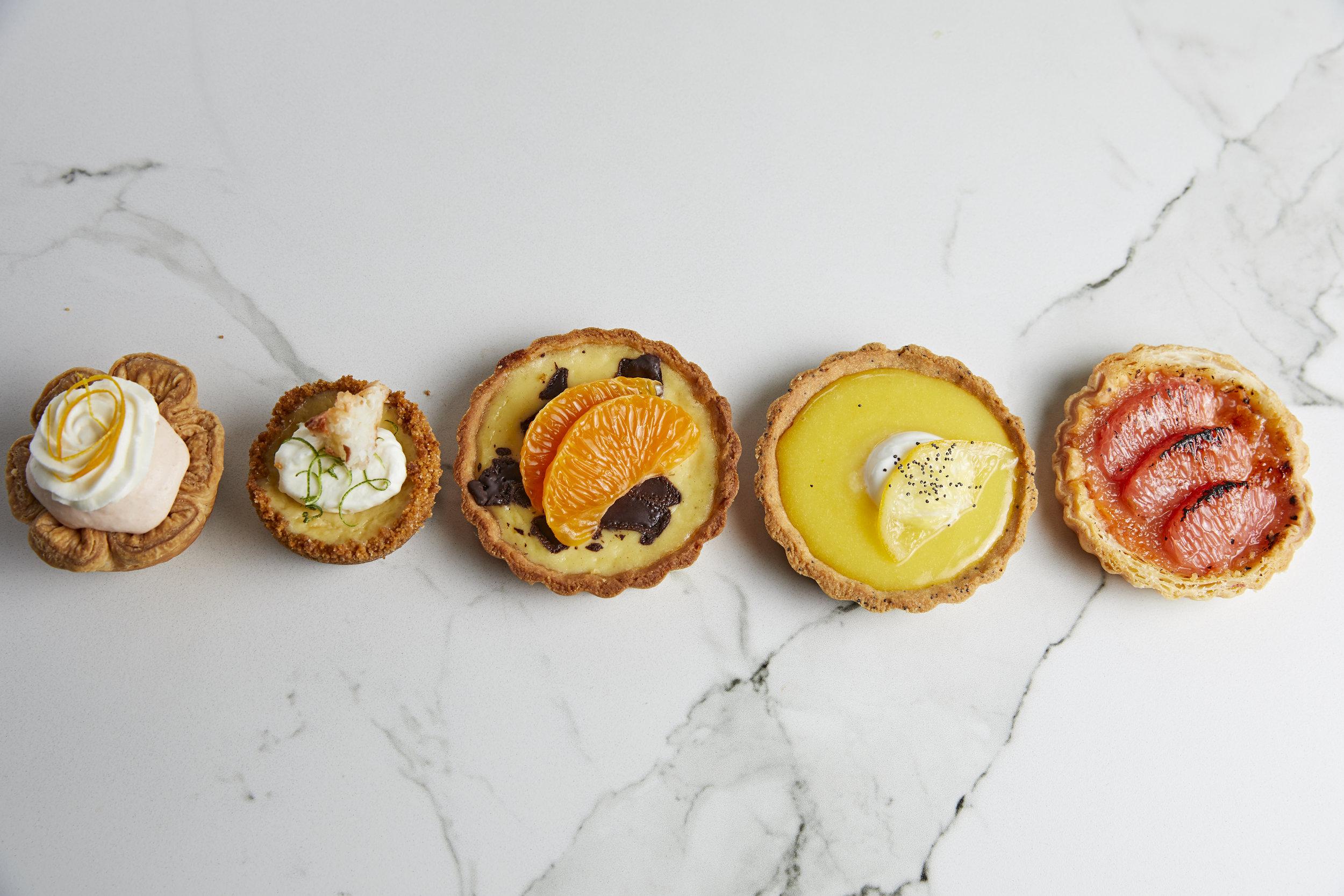 Pictured L to R: Orange Creamsicle, Coconut Lime, Ricotta Tangerine Tart, Lemon Poppyseed Tart, Grapefruit Creme Brulee
