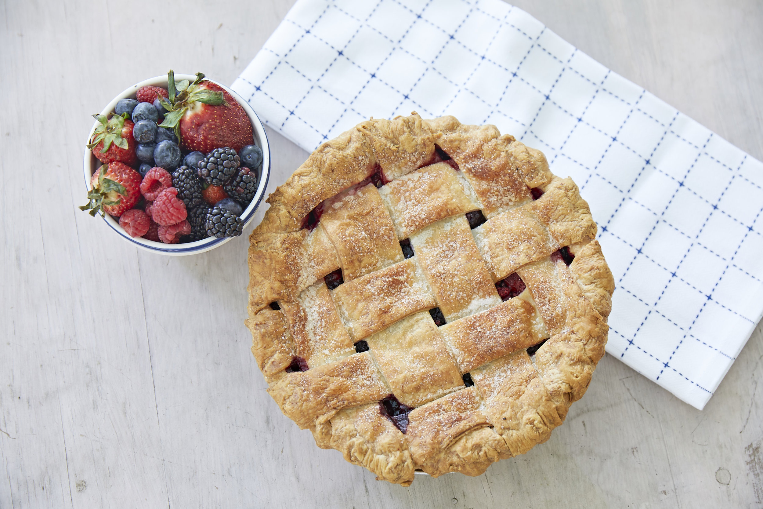 Our Not So Tiny Mixed Berry pie. A perfect for slice of shareable summer.