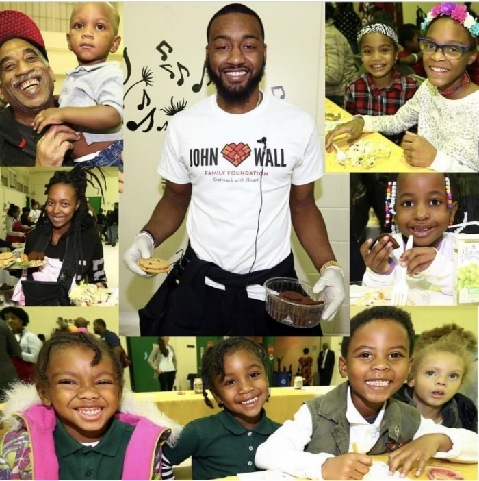 Students and families from Malcolm X ES pose for pictures during John Wall Family Foundation Thanksgiving turkey giveaway.