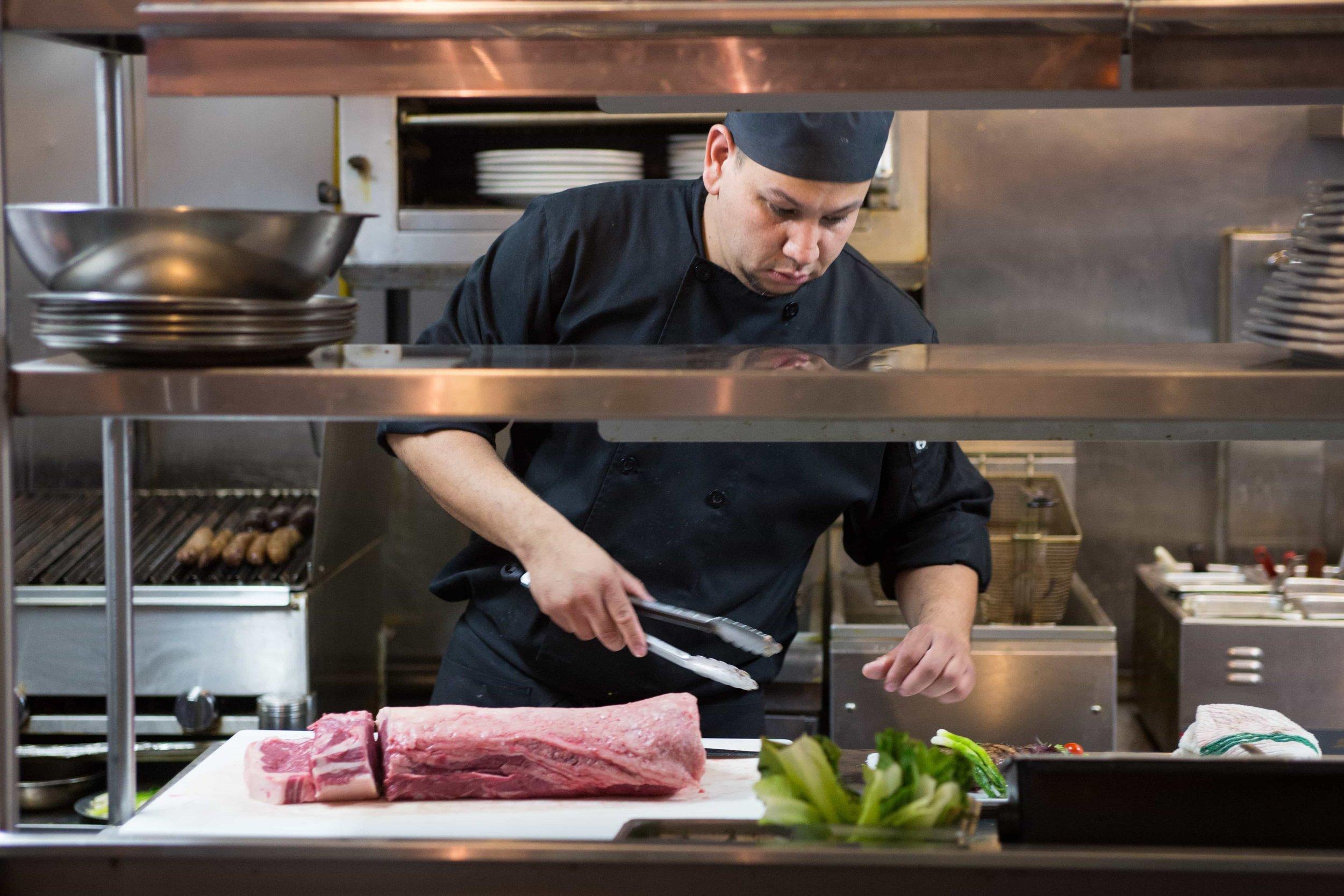 puerto-la-boca-chef-cutting-meat.jpg