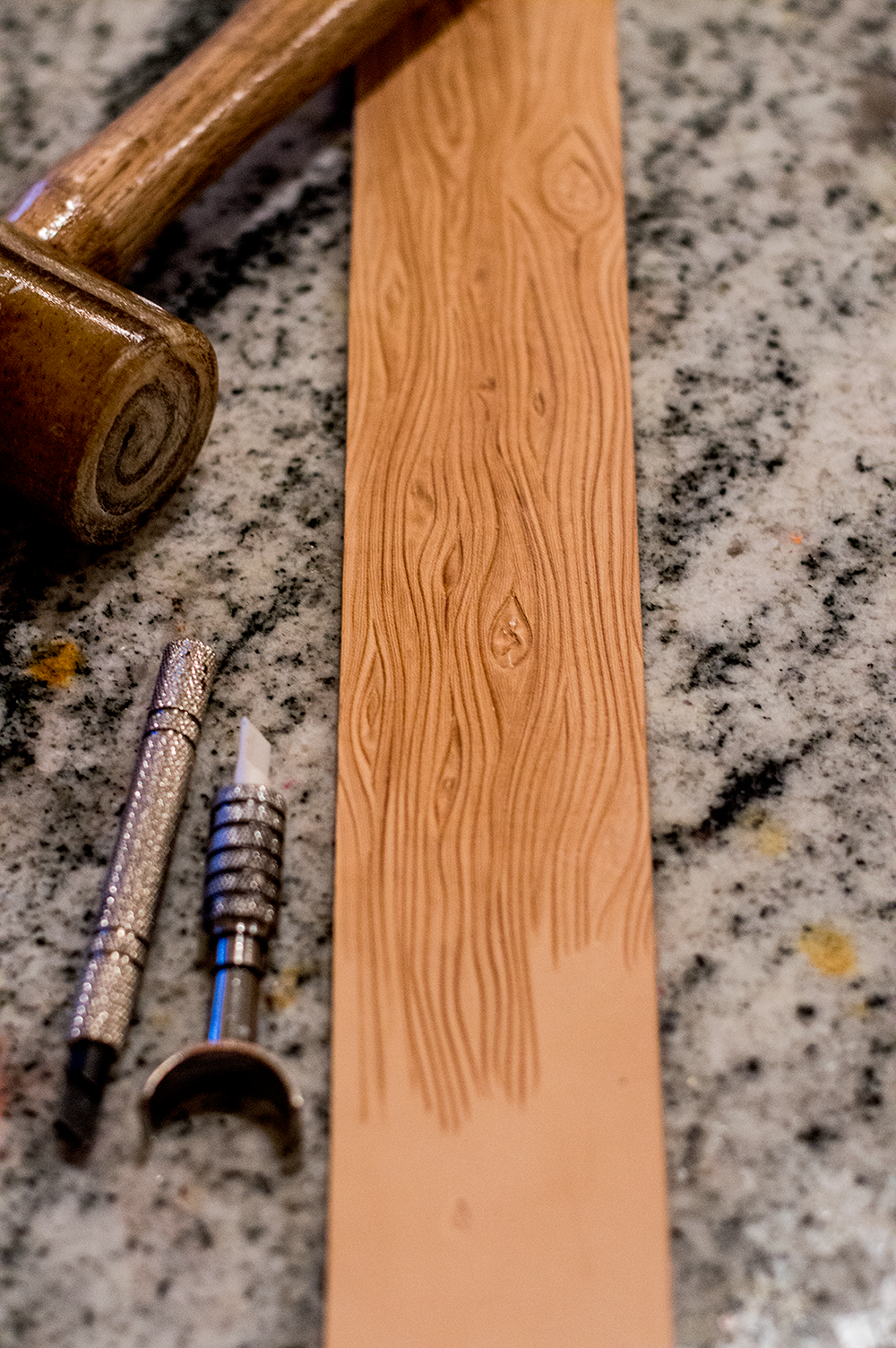 Traditional saddle making tools are used to carve and tool our 3-dimensional designs.