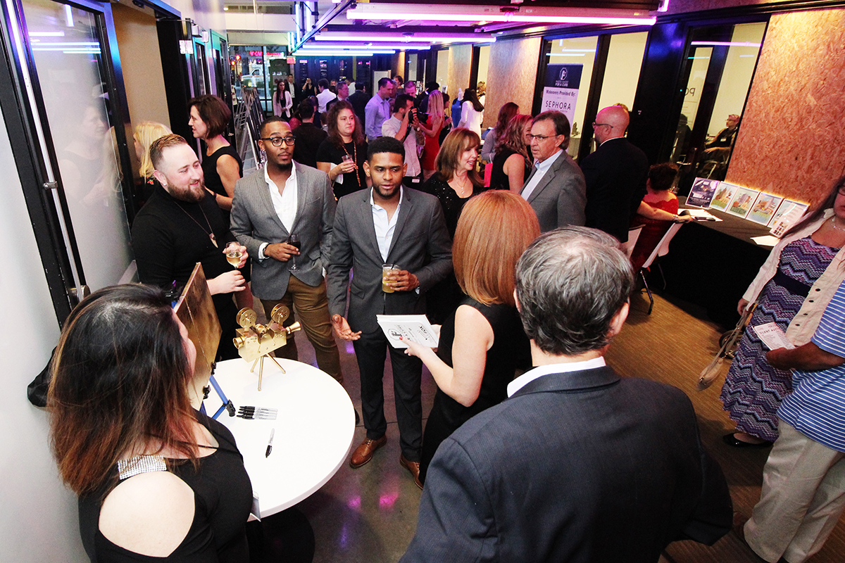 Guests mingle at the 2018 Photo Shoot for a Cure. Photo by Brian Lauritsen.