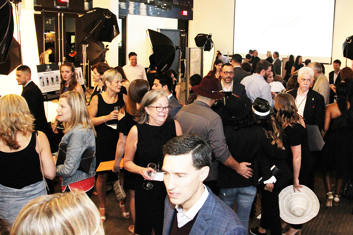 Guests mingle near the photo booths at the 2018 Photo Shoot for a Cure. Photo by Brian Lauritsen.