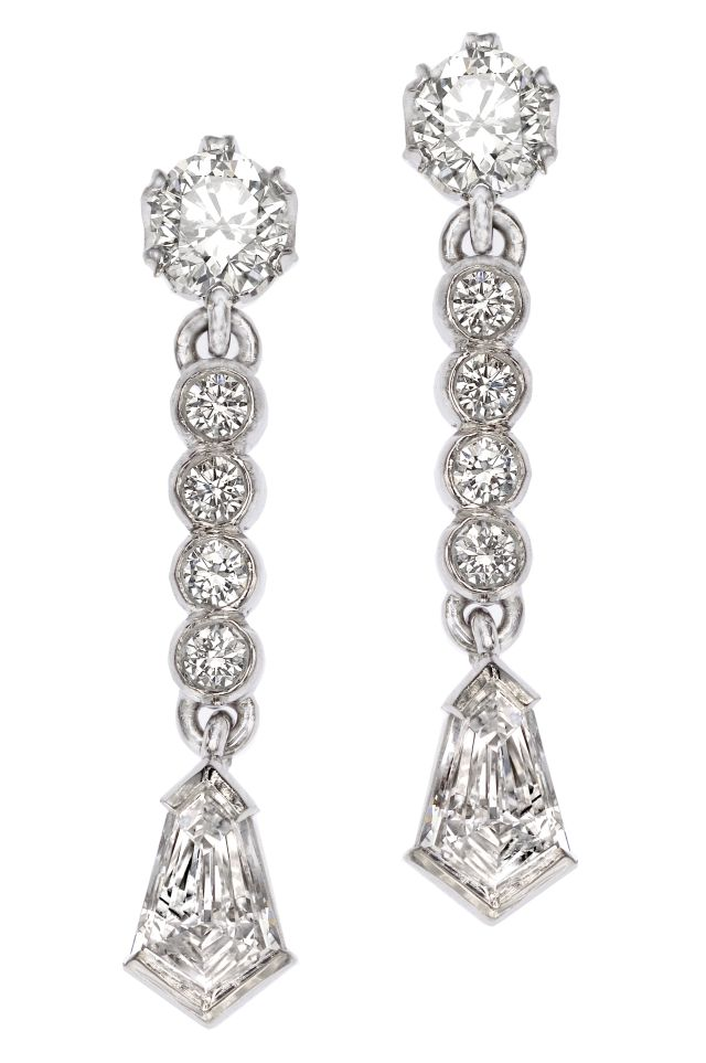 Art deco inspired diamond drop earrings in white gold with two claw-set round diamonds,  bezel-set round diamonds and two half bezel-set kite cut diamonds.