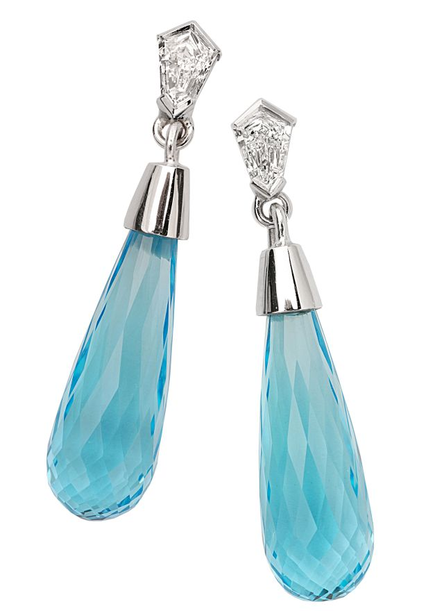 Art deco inspired drop earrings in white gold with kite cut diamonds and blue topaz briolettes.