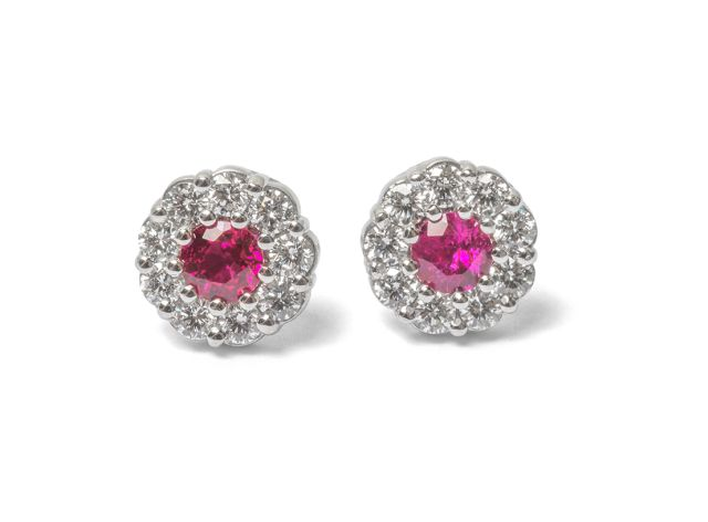 Diamond and ruby cluster studs in white gold.