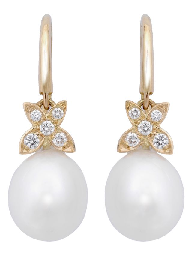 Yellow gold hook earrings with grain-set diamonds in four petal-shape detail and South Sea Broome pearls.