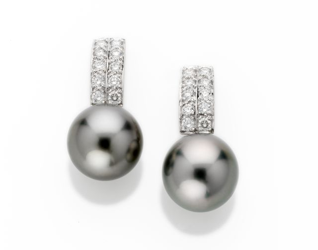 White gold earrings with double row grain-set diamonds and Tahitian pearls.