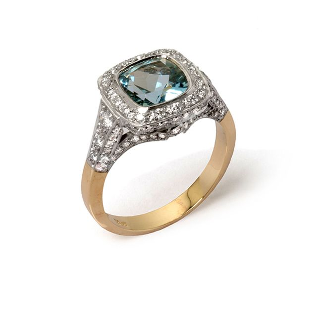 Yellow and white gold cushion cut aquamarine cluster ring with grain-set diamond halo, shoulders and band.