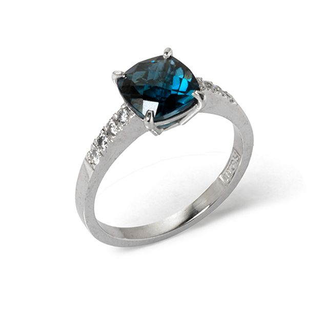 Claw-set, checkerboard cut London blue topaz with micro-set diamond shoulders in white gold.