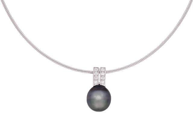 Tahitian pearl pendant with grain-set diamond double bail.