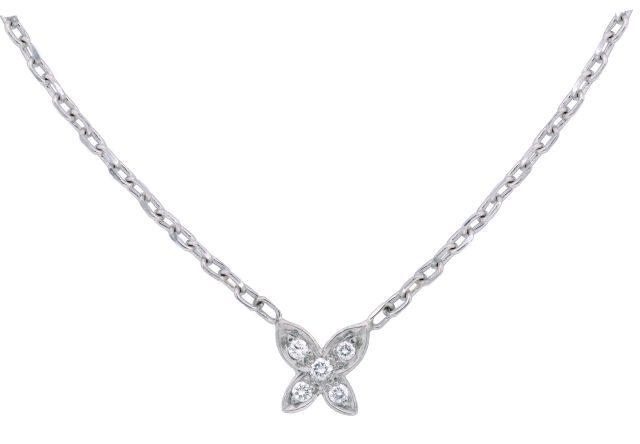 White gold four petal pendant with grain-set diamonds.