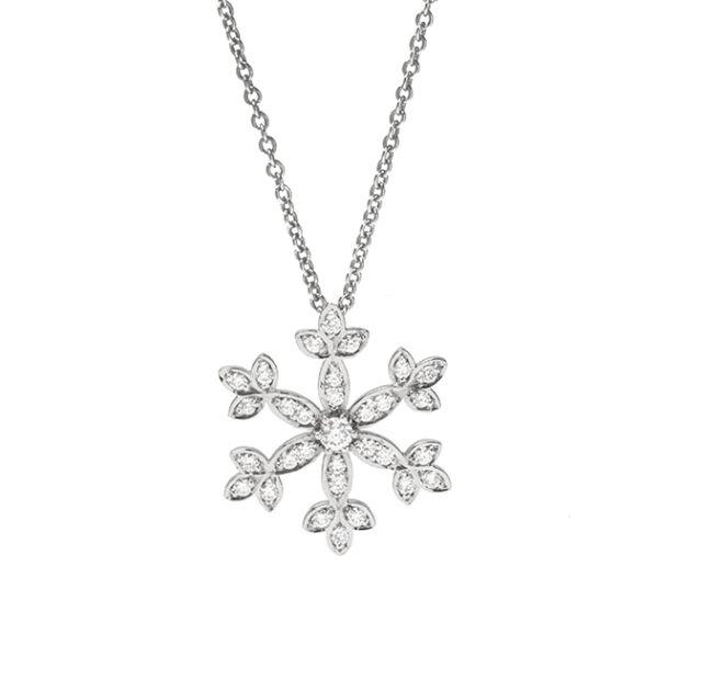 Snowflake pendant with grain-set diamonds in white gold.