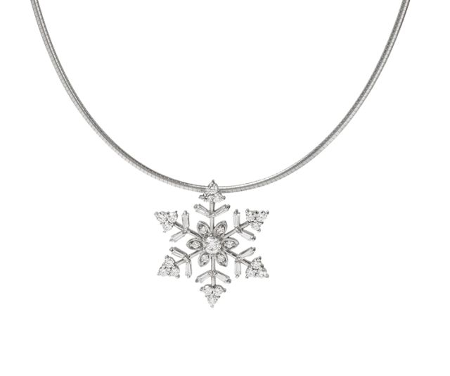 Snowflake pendant with claw-set round and baguette cut diamonds in white gold.