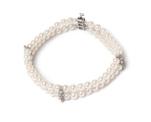 Double strand Akoya pearl bracelet with white gold diamond-set spacers.