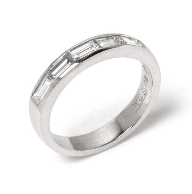 Baguette Diamonds channel-set into white gold band