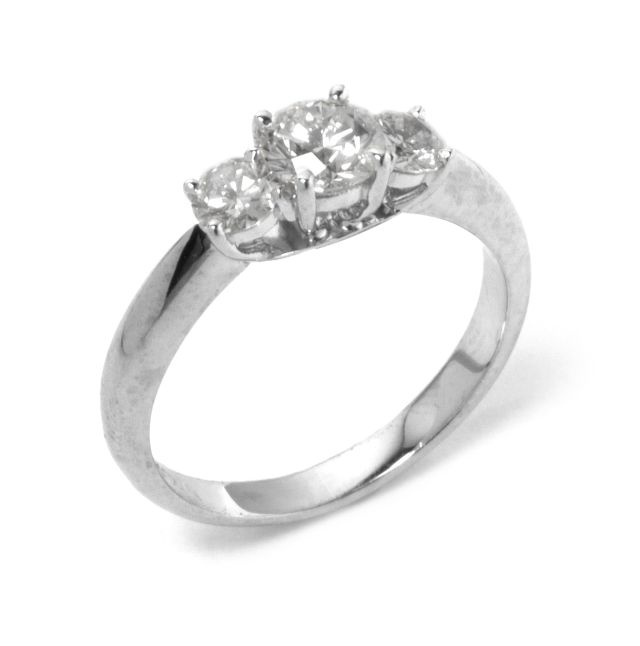 4 claw-set Diamond trilogy ring in white gold