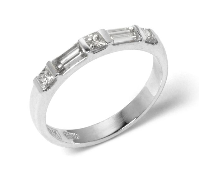 Alternating princess and baguette cut Diamonds channel-set in white gold band