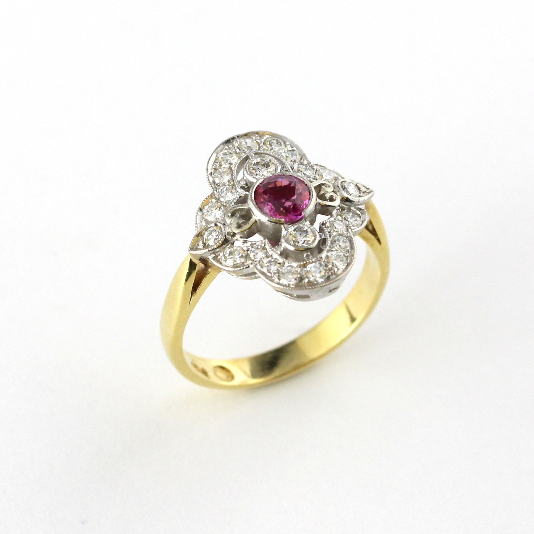 Art deco pink sapphire ring with diamonds in yellow and white gold.